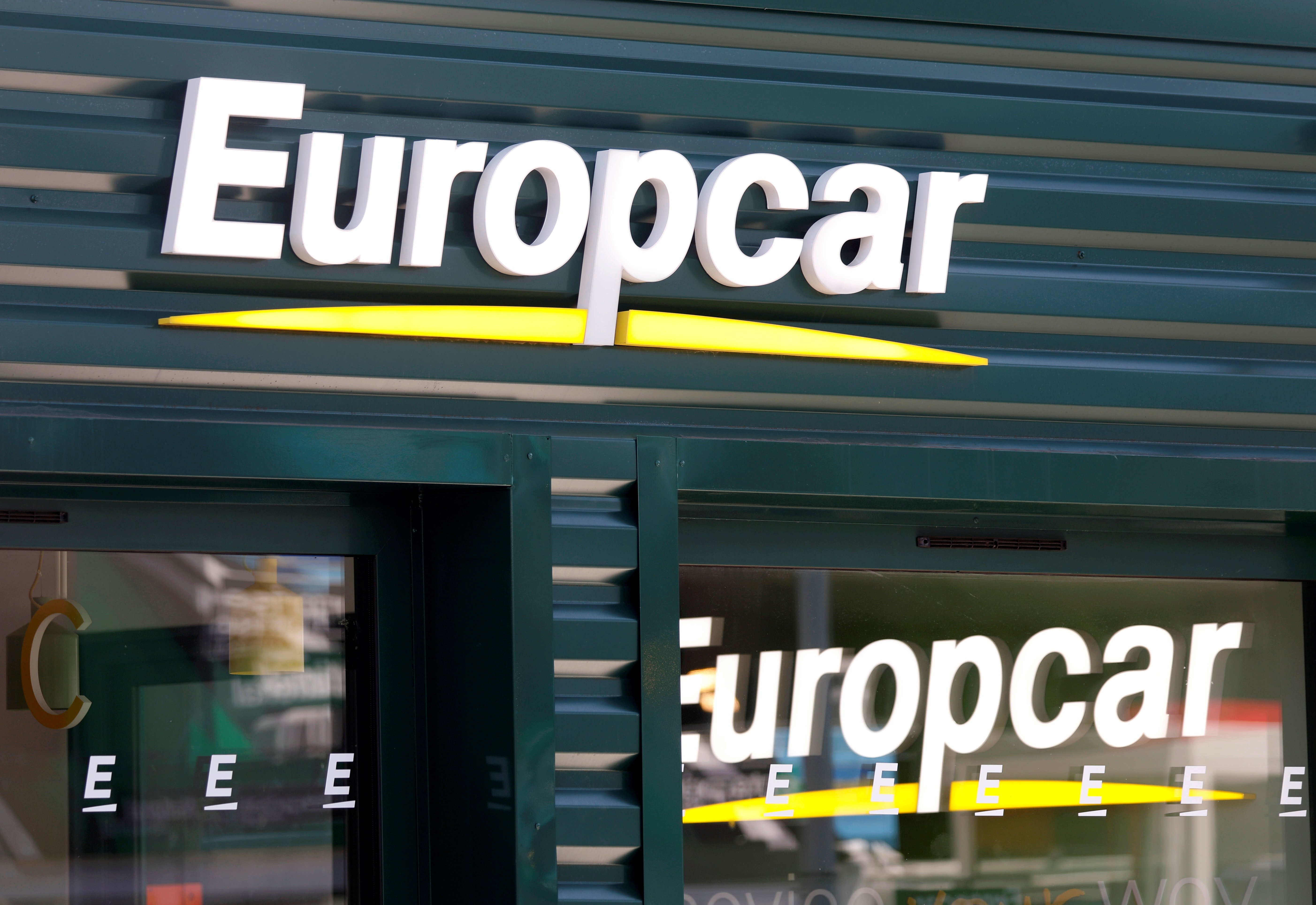 The logo of car rental company Europcar is seen outside Paris Charles de Gaulle airport in Roissy-en-France during the outbreak of the coronavirus disease (COVID-19) in France May 19, 2020.  REUTERS/Charles Platiau/File Photo