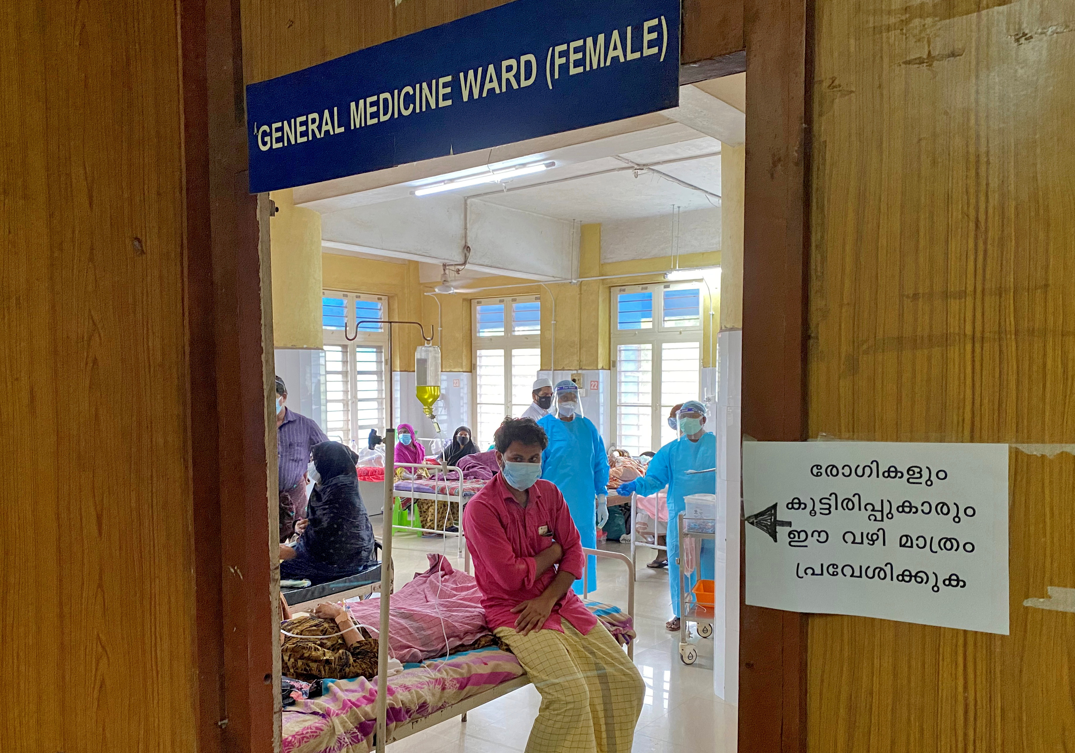 A man looks out from a coronavirus disease (COVID-19) ward in the Government Medical College Hospital in Manjeri, in the Malappuram district of the southern state of Kerala, India. August 18, 2021. Picture taken August 18, 2021. REUTERS/Krishna N. Das