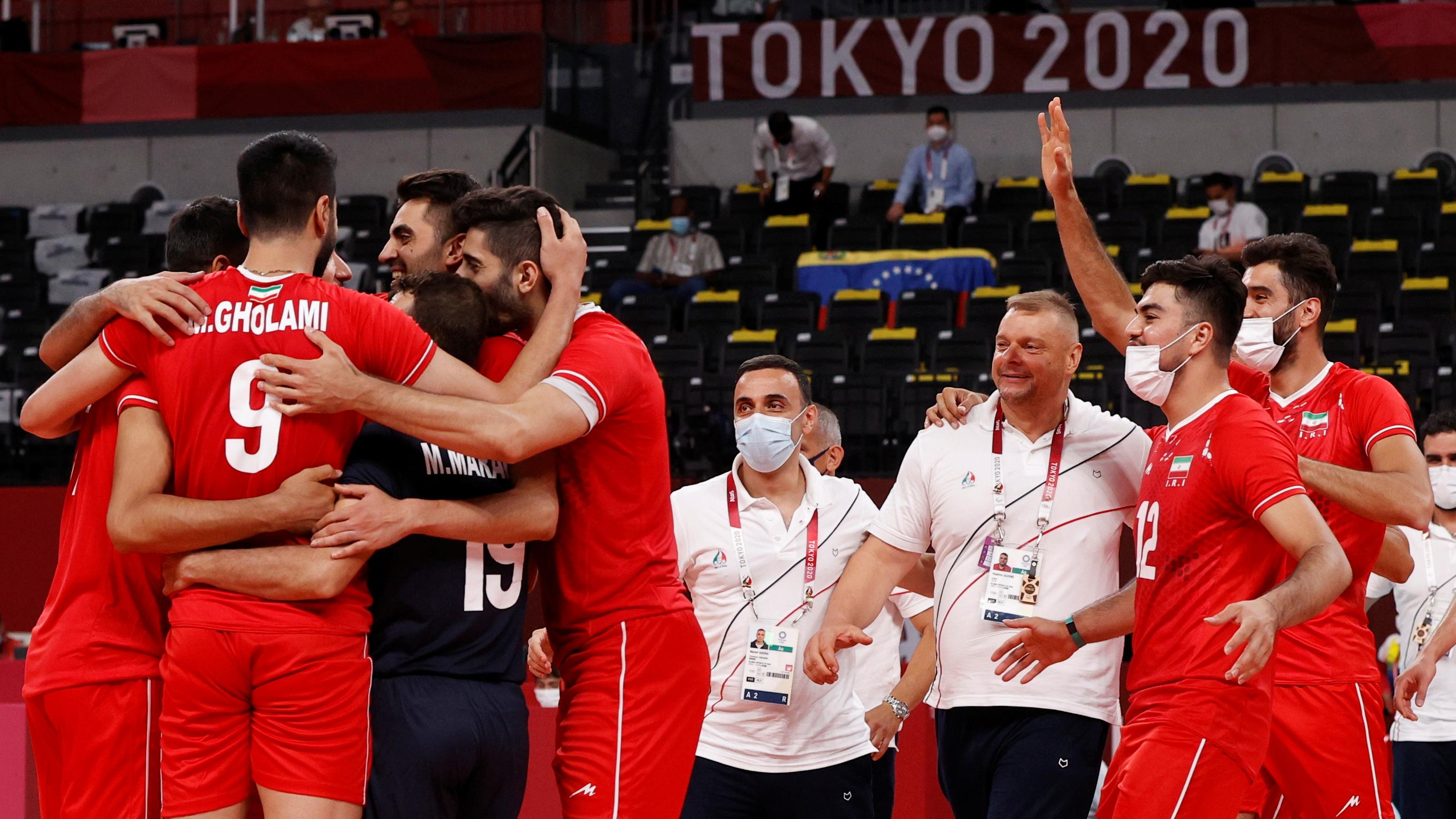 Tokyo 2020 Olympics - Volleyball - Men's Pool A - Iran v Venezuela - Ariake Arena, Tokyo, Japan – July 26, 2021. Team members of Iran celebrate after the match. REUTERS/Valentyn Ogirenko