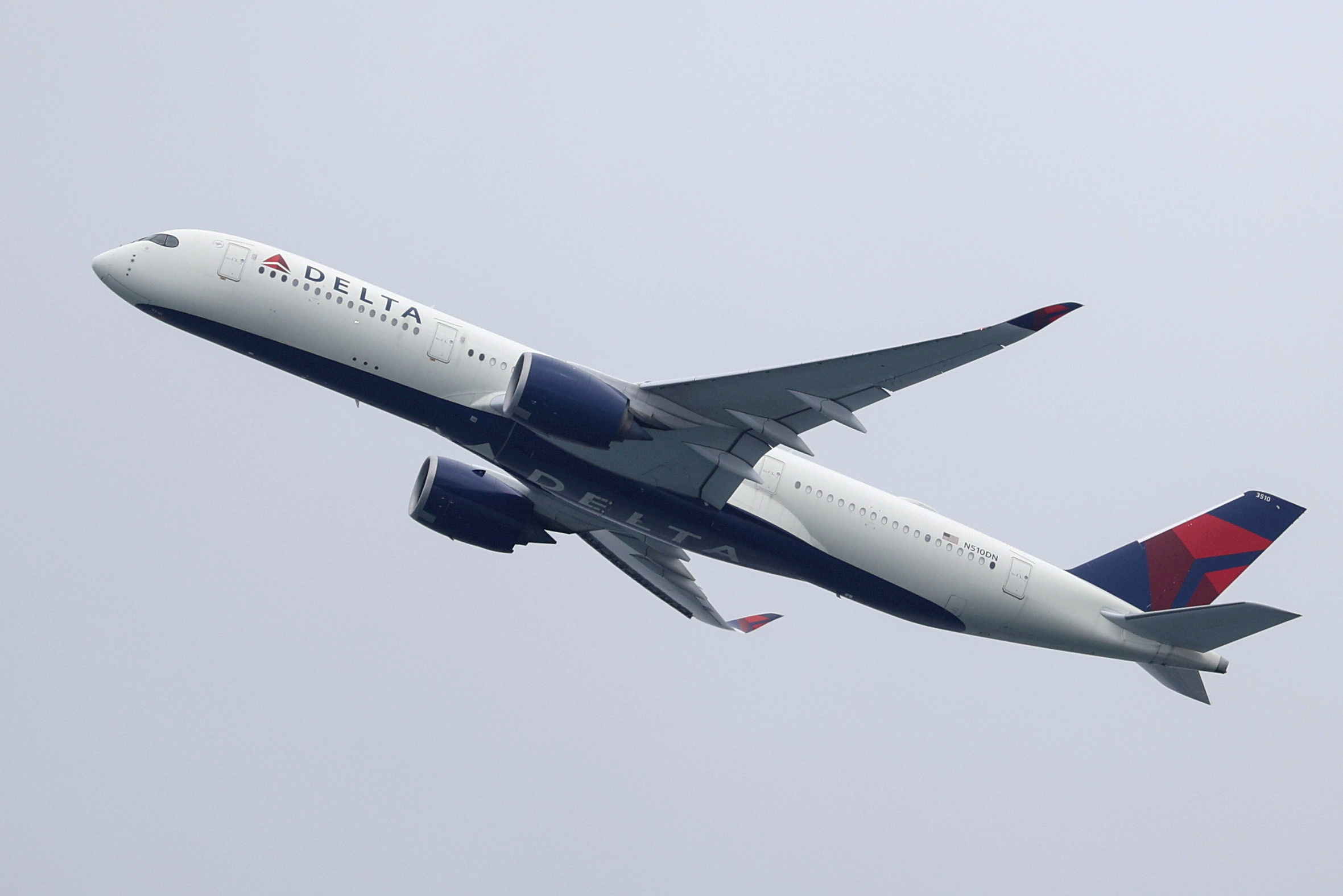 A Delta Air Lines Airbus A350-900 plane takes off from Sydney Airport in Sydney, Australia, October 28, 2020. REUTERS/Loren Elliott