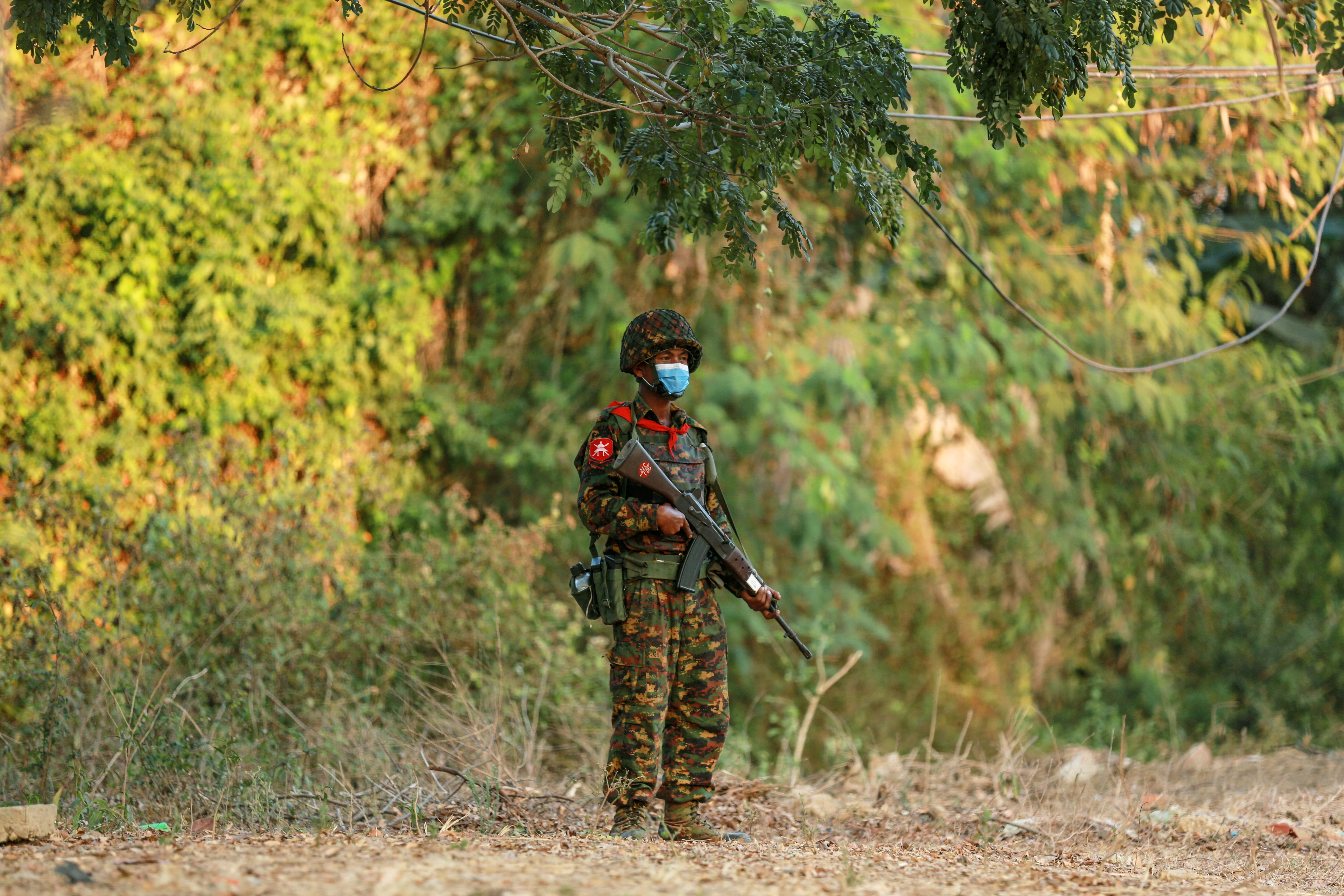 A Myanmar's soldier stands guard near the congress compound in Naypyitaw, Myanmar, February 2, 2021. REUTERS/Stringer
