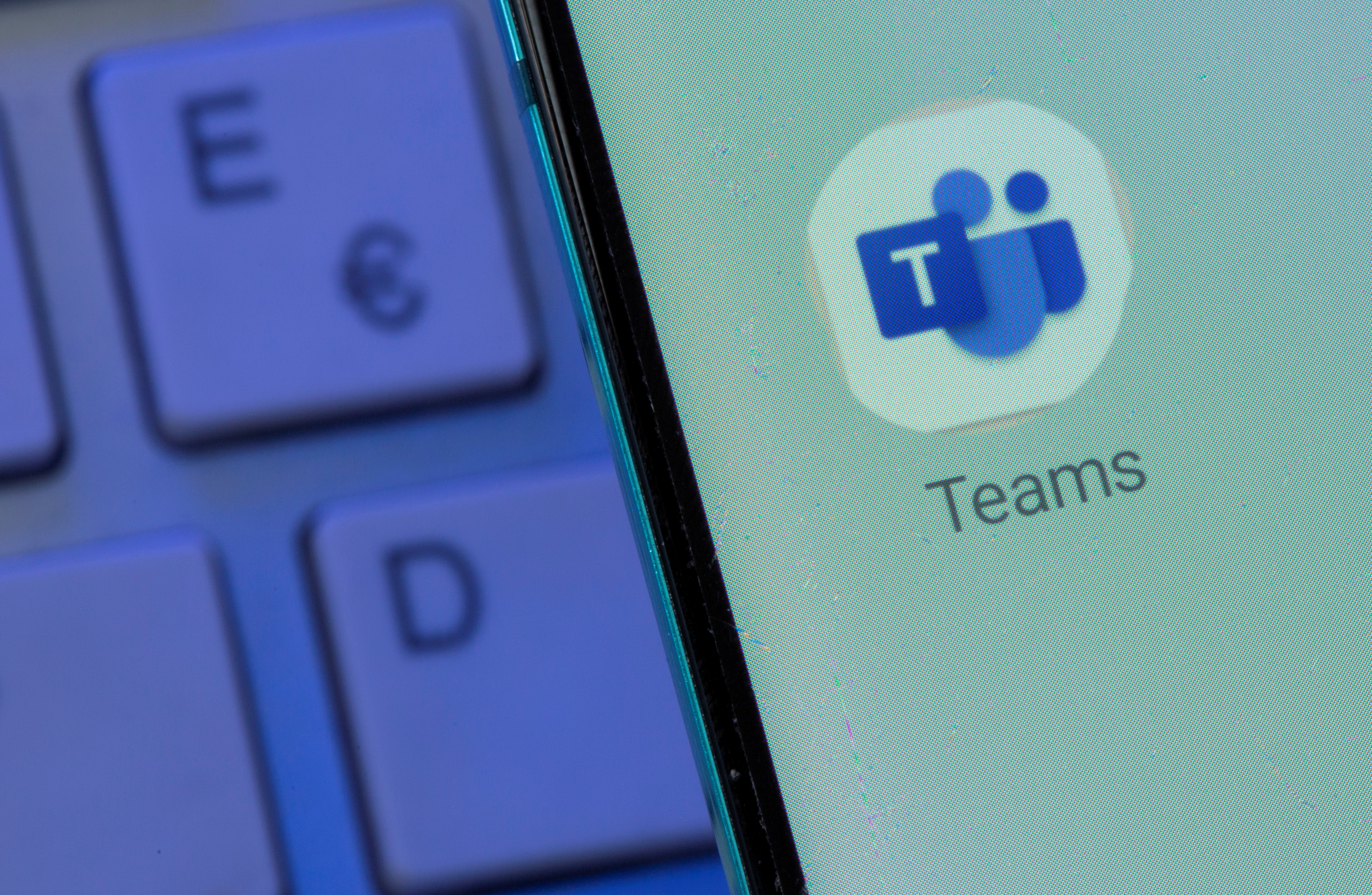 Microsoft Teams app is seen on the smartphone placed on the keyboard in this illustration taken, July 26, 2021. REUTERS/Dado Ruvic/Illustration/File Photo