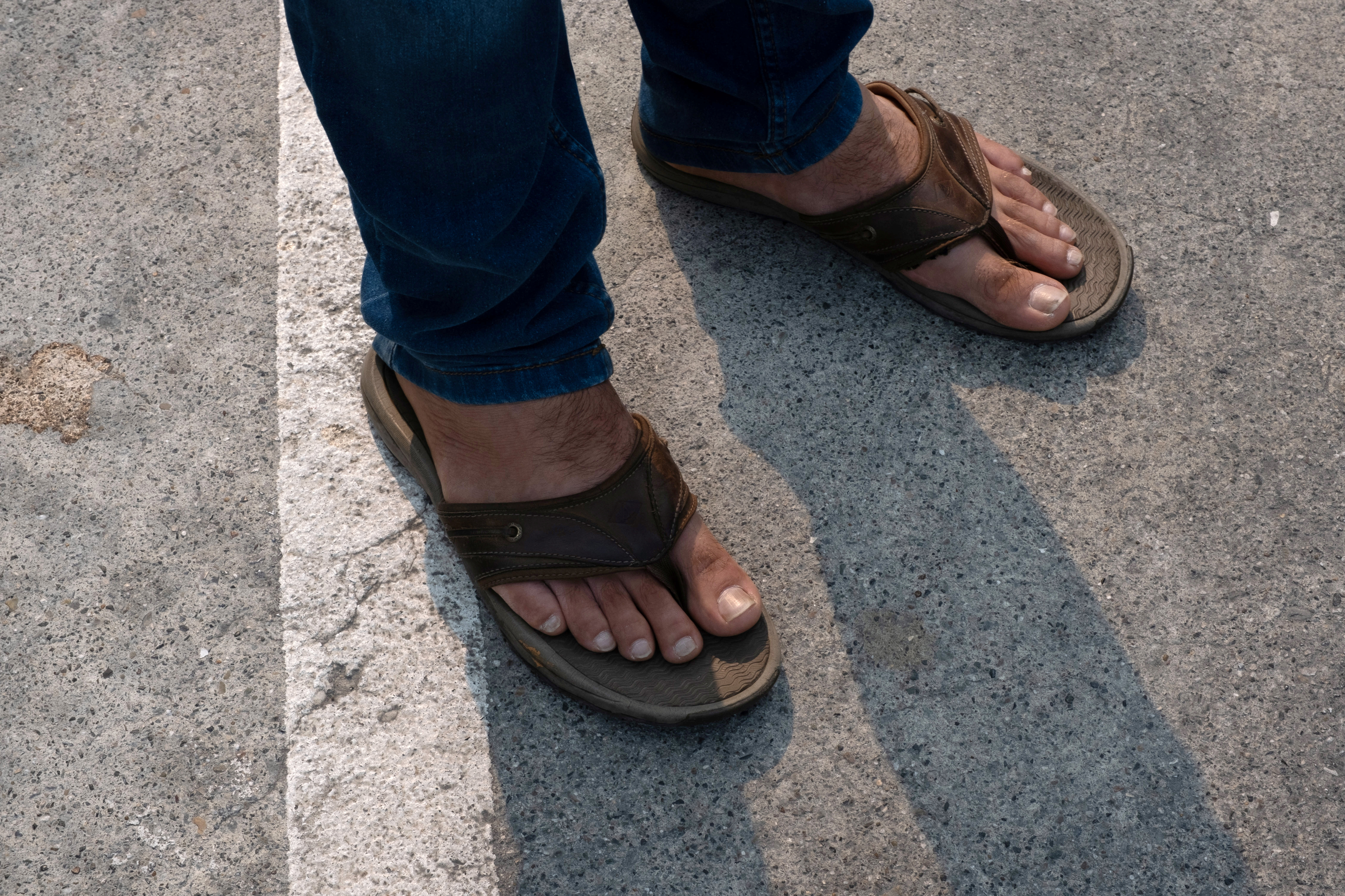 A photo of Afghan SIV recipient Abdul Noori's feet in Burlingame, California, U.S., August 19, 2021. Picture taken August 19, 2021.  REUTERS/Nick Otto