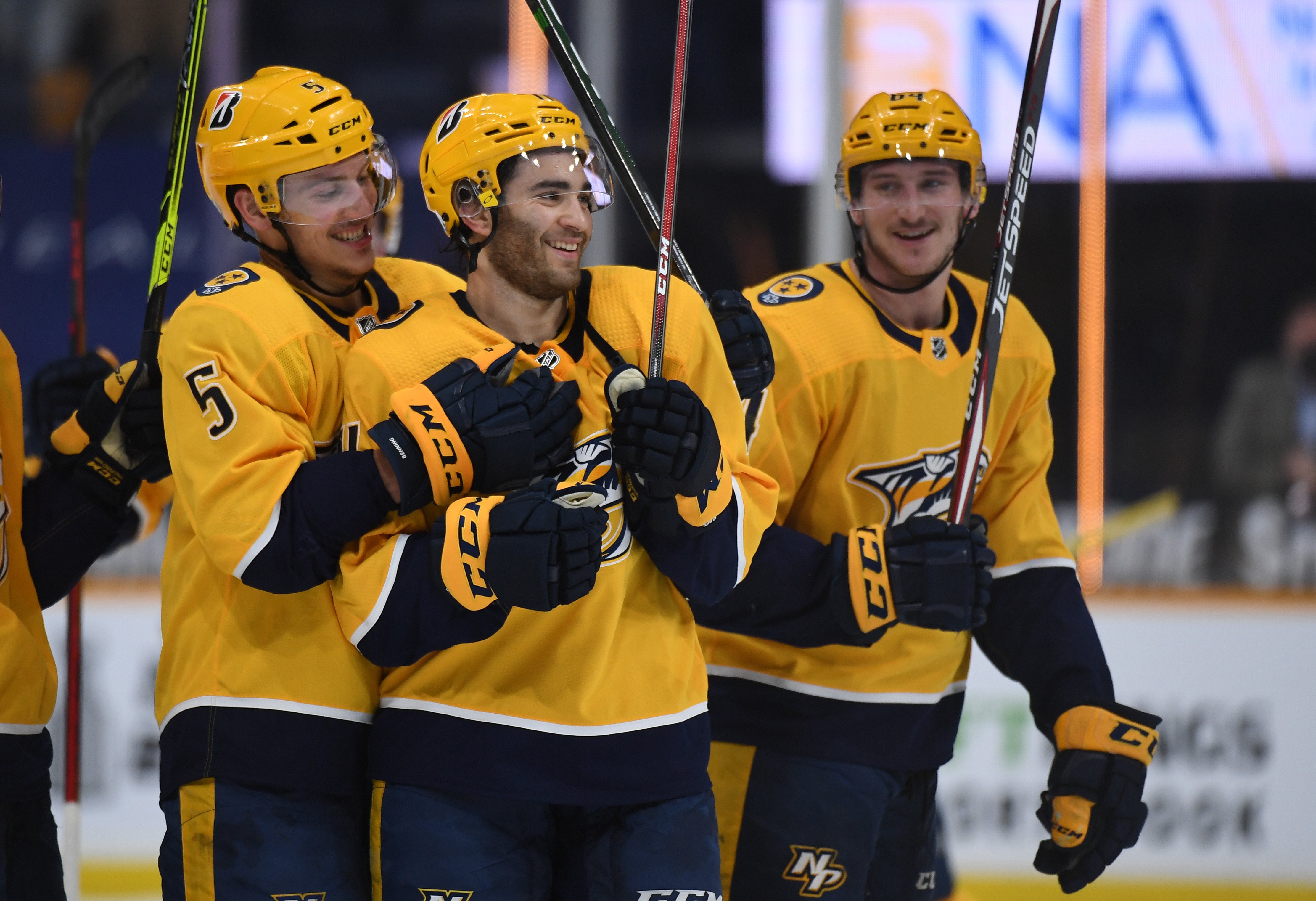May 8, 2021; Nashville, Tennessee, USA; Nashville Predators center Luke Kunin (11) is congratulated by teammates after scoring two goals in the playoff-clinching win over the Carolina Hurricanes at Bridgestone Arena. Mandatory Credit: Christopher Hanewinckel-USA TODAY Sports