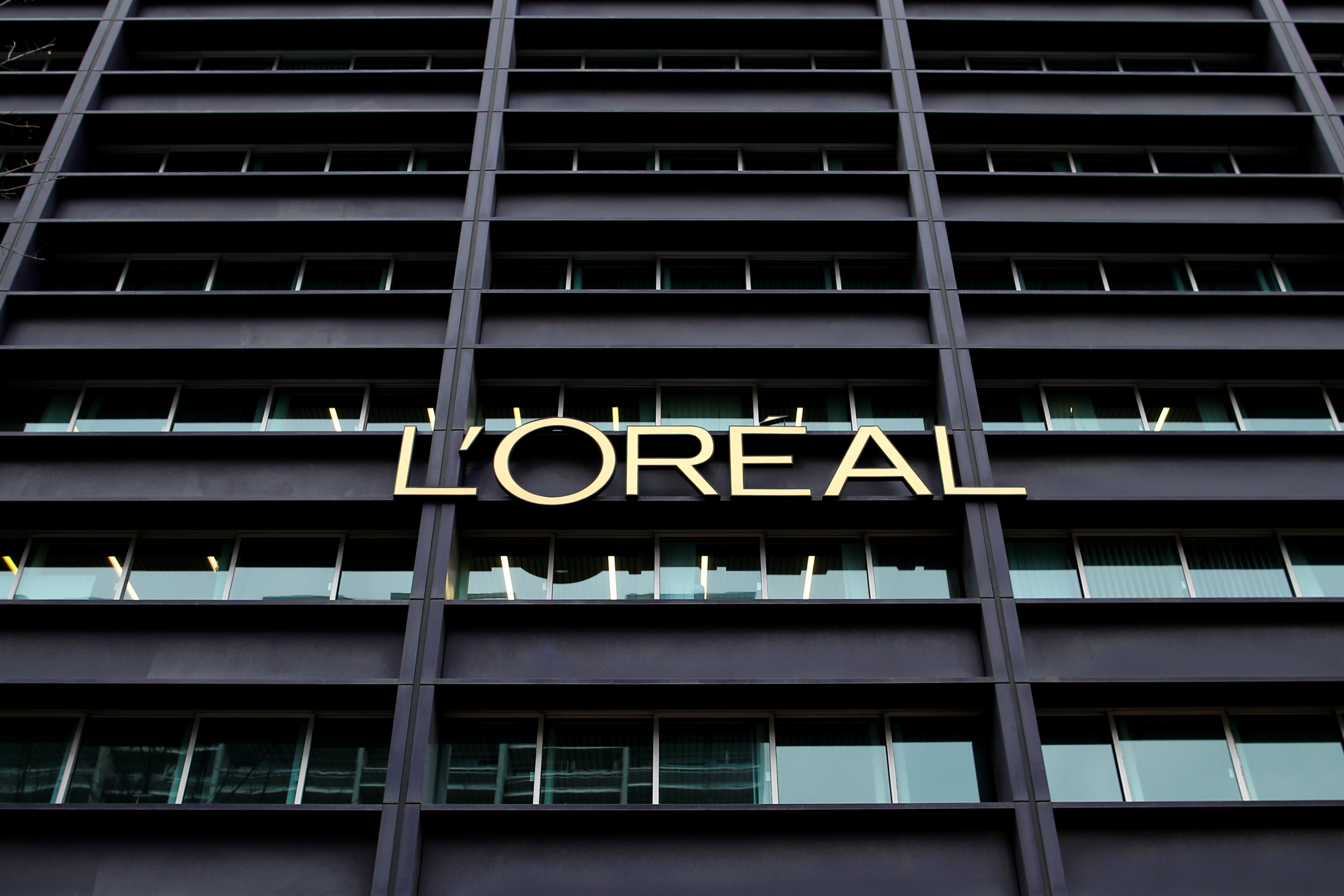 The logo of French cosmetics group L'Oreal is seen on the company's building in Clichy, near Paris February 11, 2014. REUTERS/Benoit Tessier/File Photo