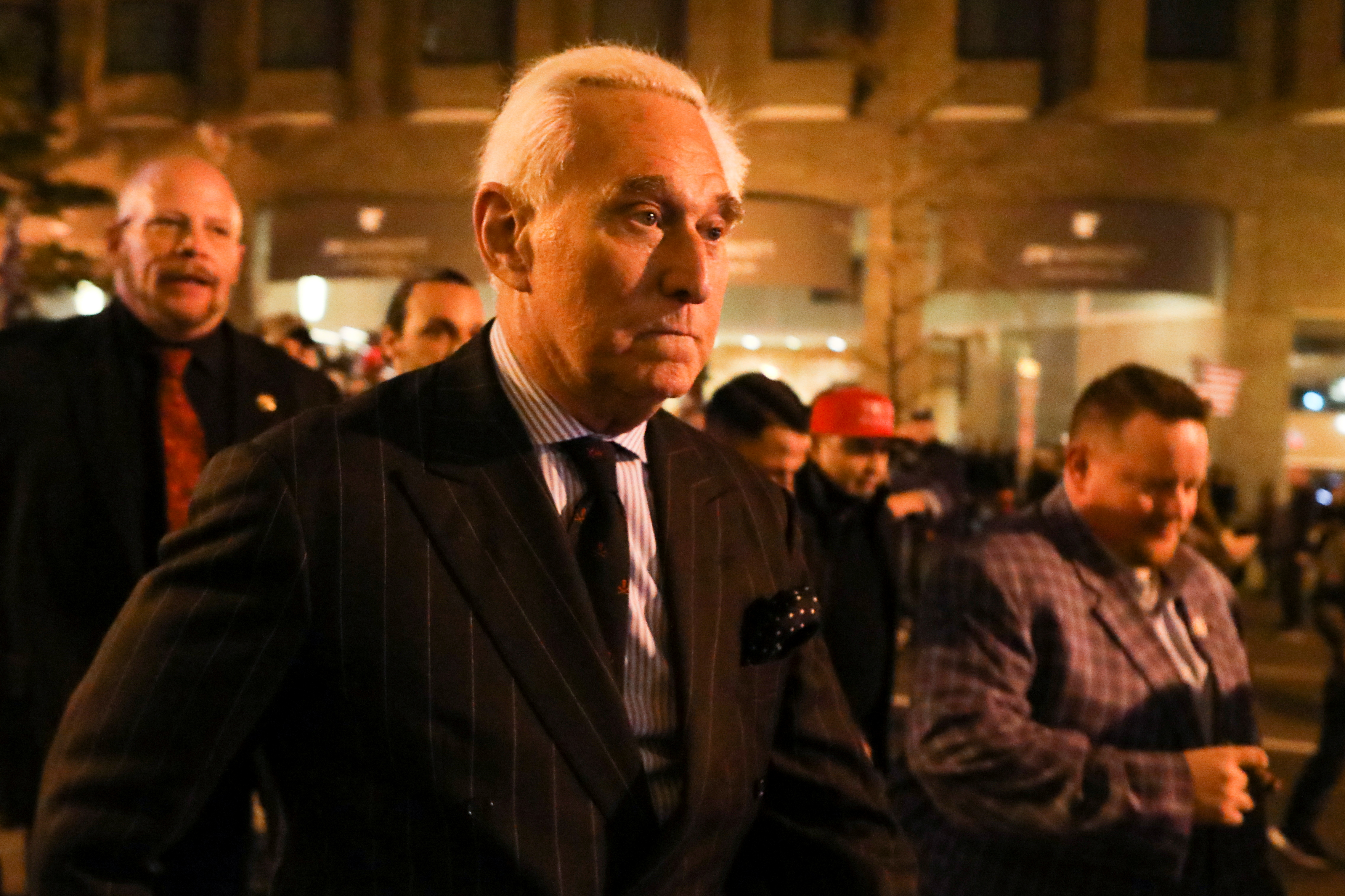 Roger Stone, a longtime friend and adviser of U.S. President Donald Trump, walks as supporters of Trump and members of the far-right Proud Boys march the night before rallies to protest the U.S. presidential election results, in Washington, D.C., U.S., December 11, 2020. REUTERS/Jim Urquhart