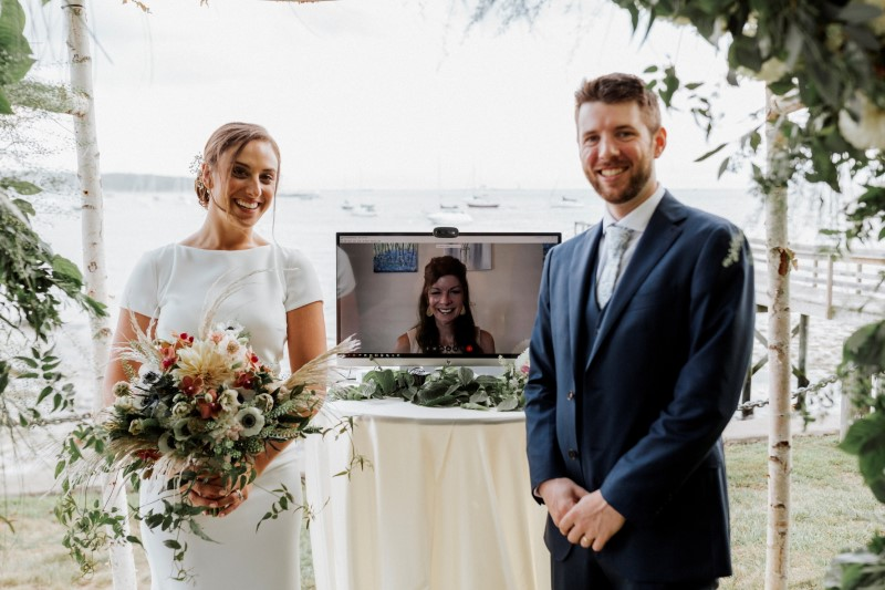 Ali and Adam Whitman are married by their aunt during their Zoom wedding ceremony in Kittery, Maine, U.S., August 22, 2020.  Courtney Elizabeth/Handout via REUTERS