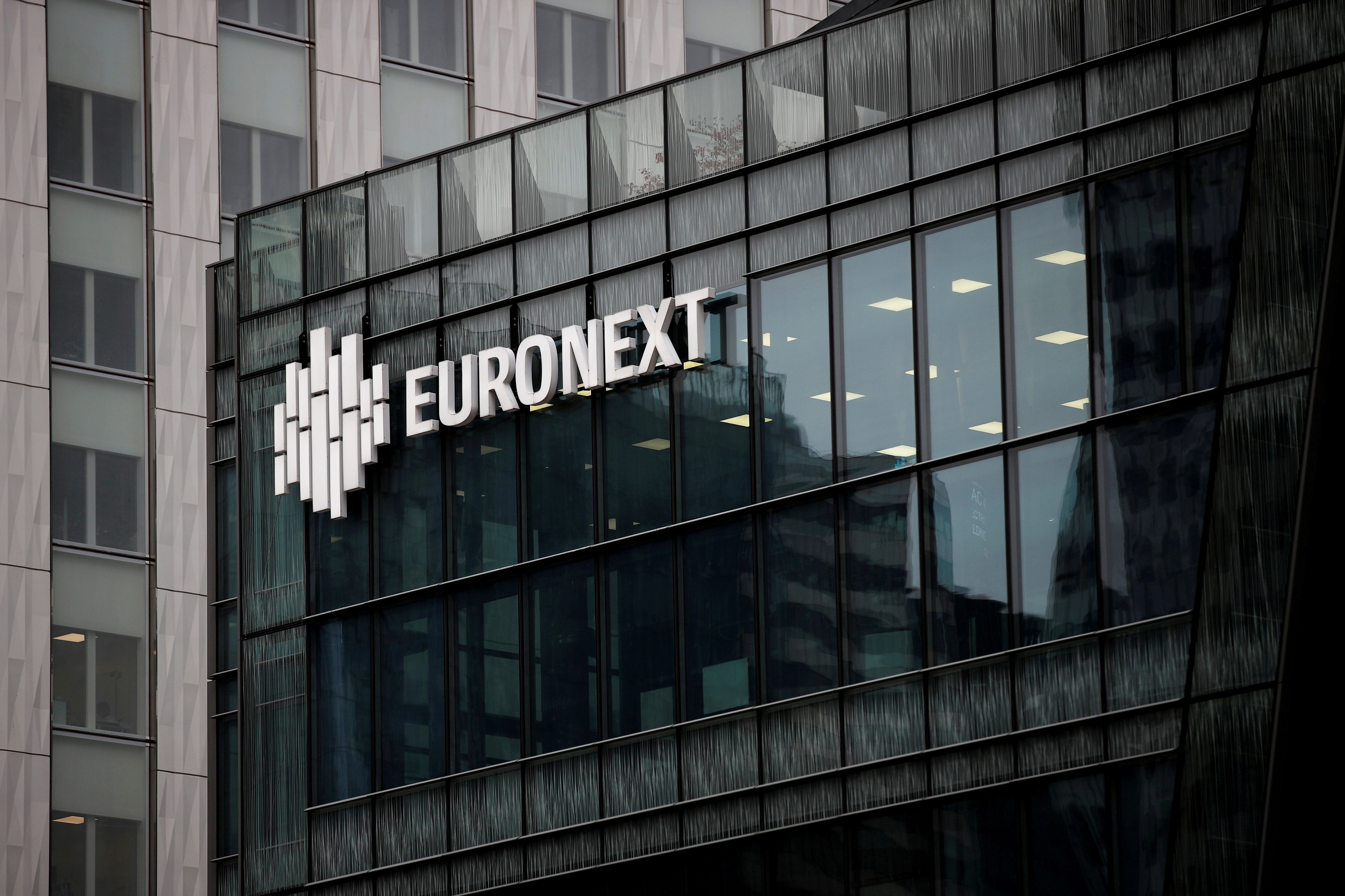 The Euronext logo is seen at the financial and business district of La Defense, amid the outbreak of the coronavirus disease (COVID-19), in Paris, France, November 10, 2020. REUTERS/Benoit Tessier/File Photo