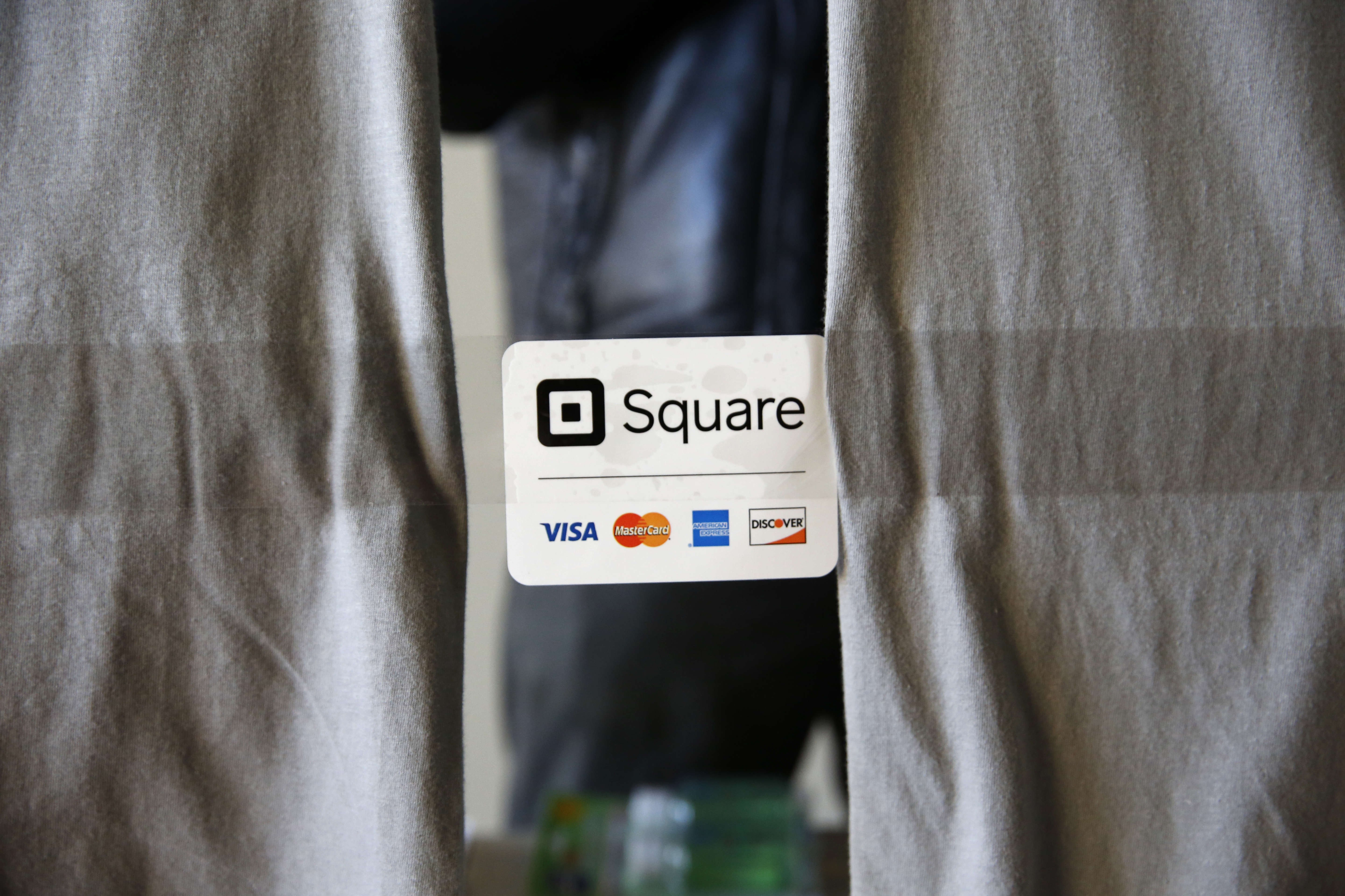 An advertisement for the Square Inc payment processor is seen outside a vendors site along the High Line in New York March 9, 2016. REUTERS/Shannon Stapleton