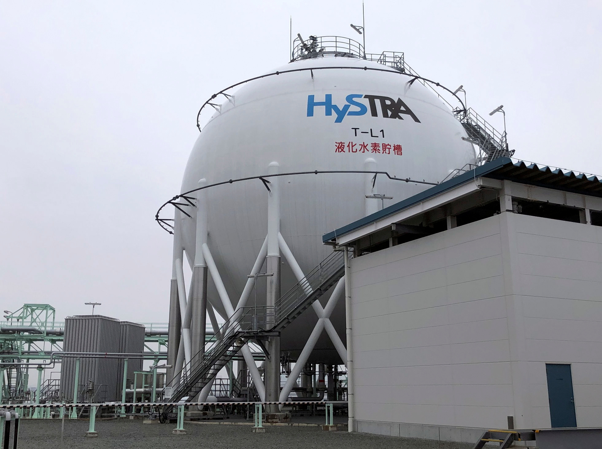 The logo of the CO2-free Hydrogen Energy Supply-chain Technology Research Association (HySTRA) is seen on a liquefied hydrogen storage tank built by Kawasaki Heavy Industries at the hydrogen receiving terminal at the Kobe Airport Island in Kobe, western Japan January 22, 2021. REUTERS/Yuka Obayashi