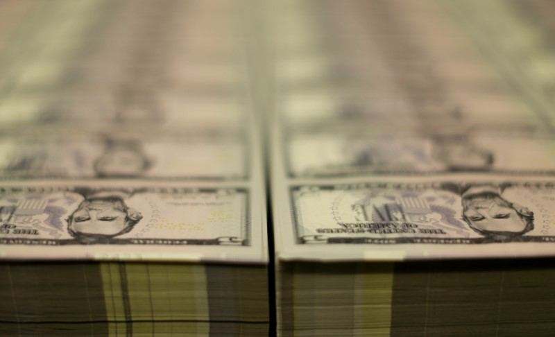 Stacks of former U.S. President Abraham Lincoln on the five-dollar bill currency are seen at the Bureau of Engraving and Printing in Washington March 26, 2015. REUTERS/Gary Cameron