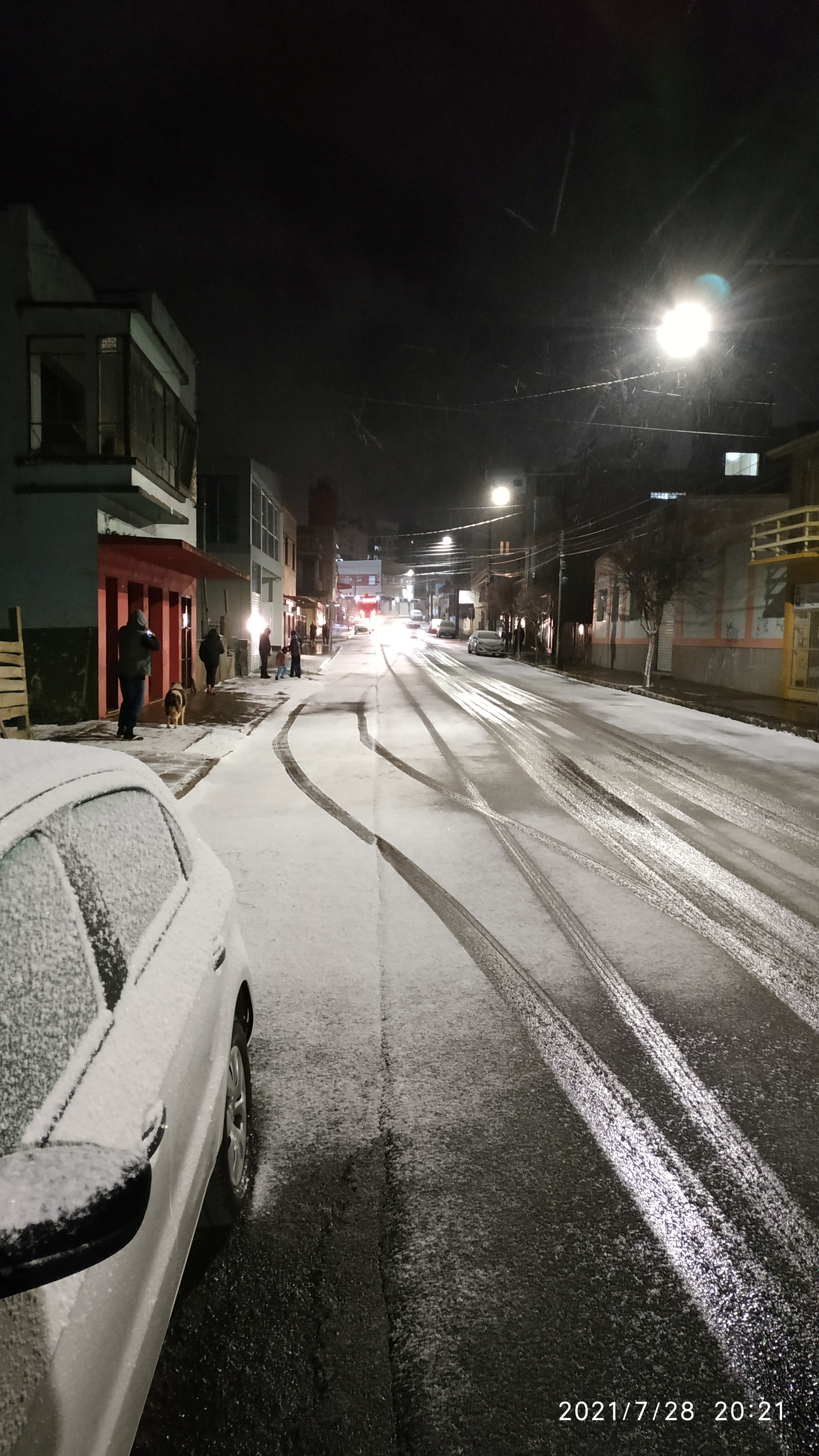 General view of a street covered in snow in Vacaria, Rio Grande do Sul, Brazil July 28, 2021, in this picture obtained from social media.  Picture taken July 28, 2021. TWITTER @Lho_nardo via REUTERS