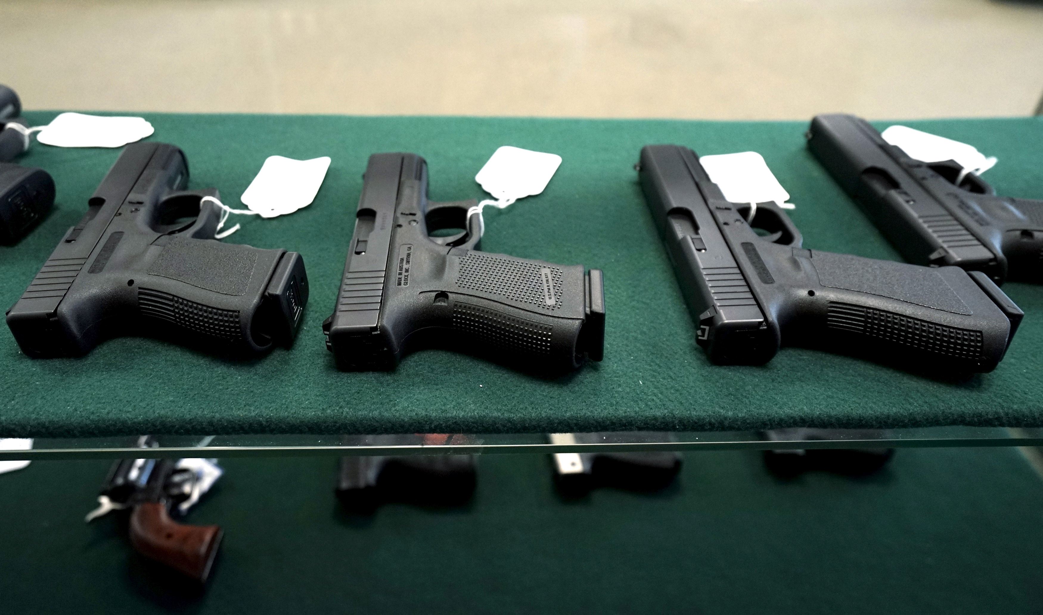 A selection of Glock pistols are seen for sale at the Pony Express Firearms shop in Parker, Colorado December 7, 2015. REUTERS/Rick Wilking