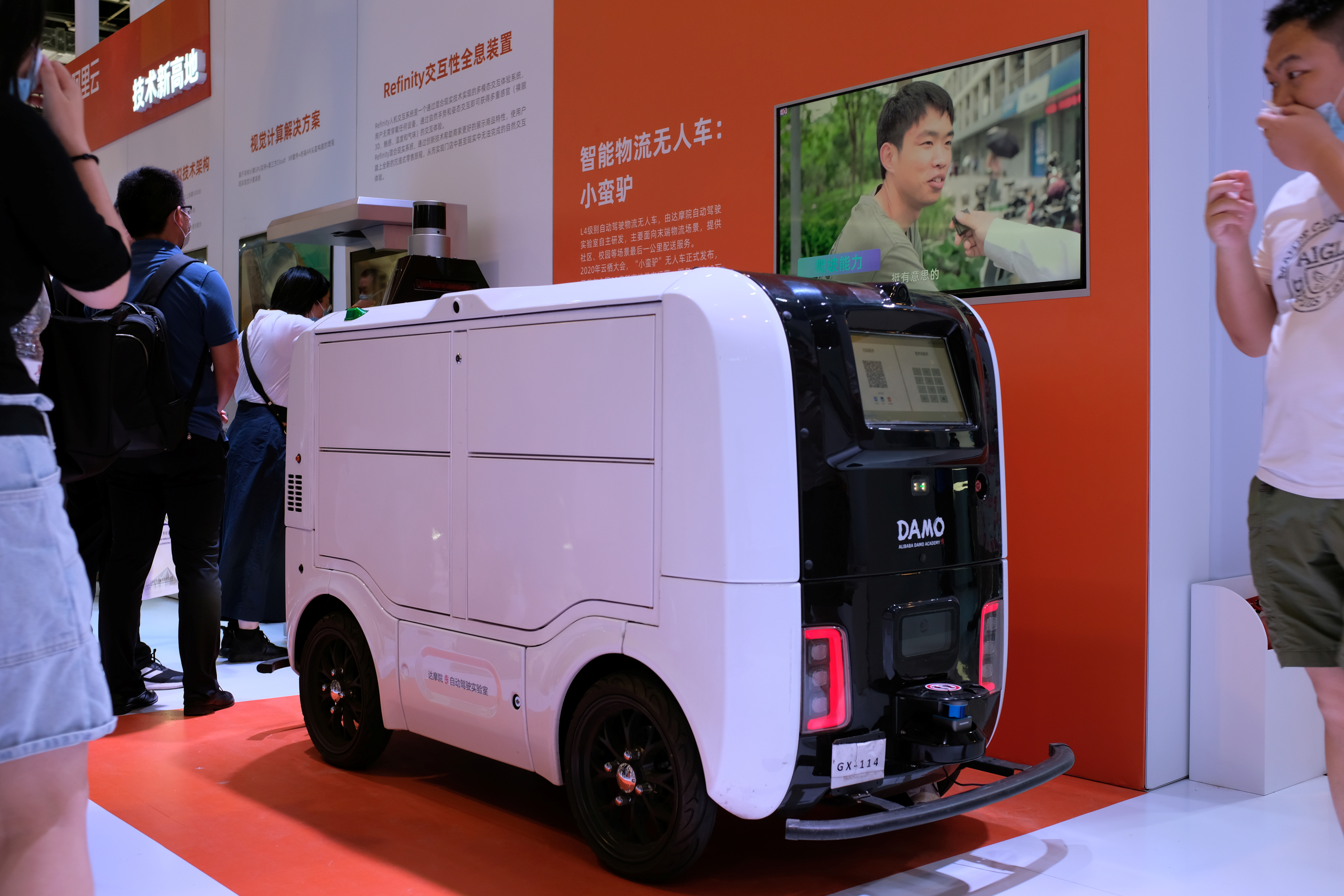 An autonomous delivery vehicle by Damo is displayed at the World Artificial Intelligence Conference (WAIC) in Shanghai, China July 8, 2021. REUTERS/Yilei Sun