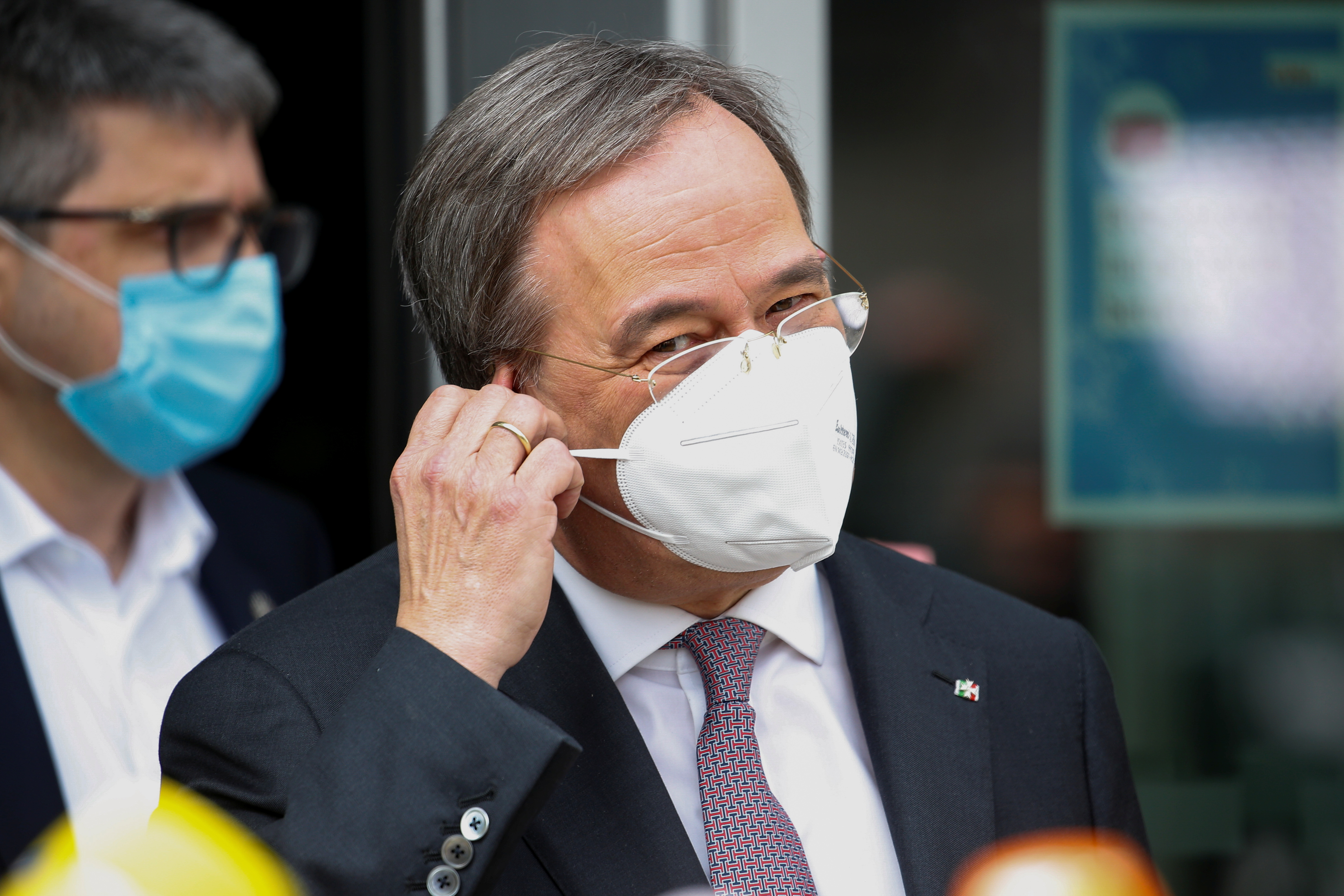 North Rhine-Westphalia's State Premier and head of Germany's conservative Christian Democratic Union (CDU) party Armin Laschet adjusts his face mask as he leaves after meetings at the CDU headquarters in Berlin, Germany, April 19, 2021. REUTERS/Michele Tantussi