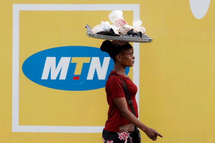 A woman walks past an advertising posters for MTN telecommunication company along a street in Lagos, Nigeria August 28, 2019. REUTERS/Temilade Adelaja