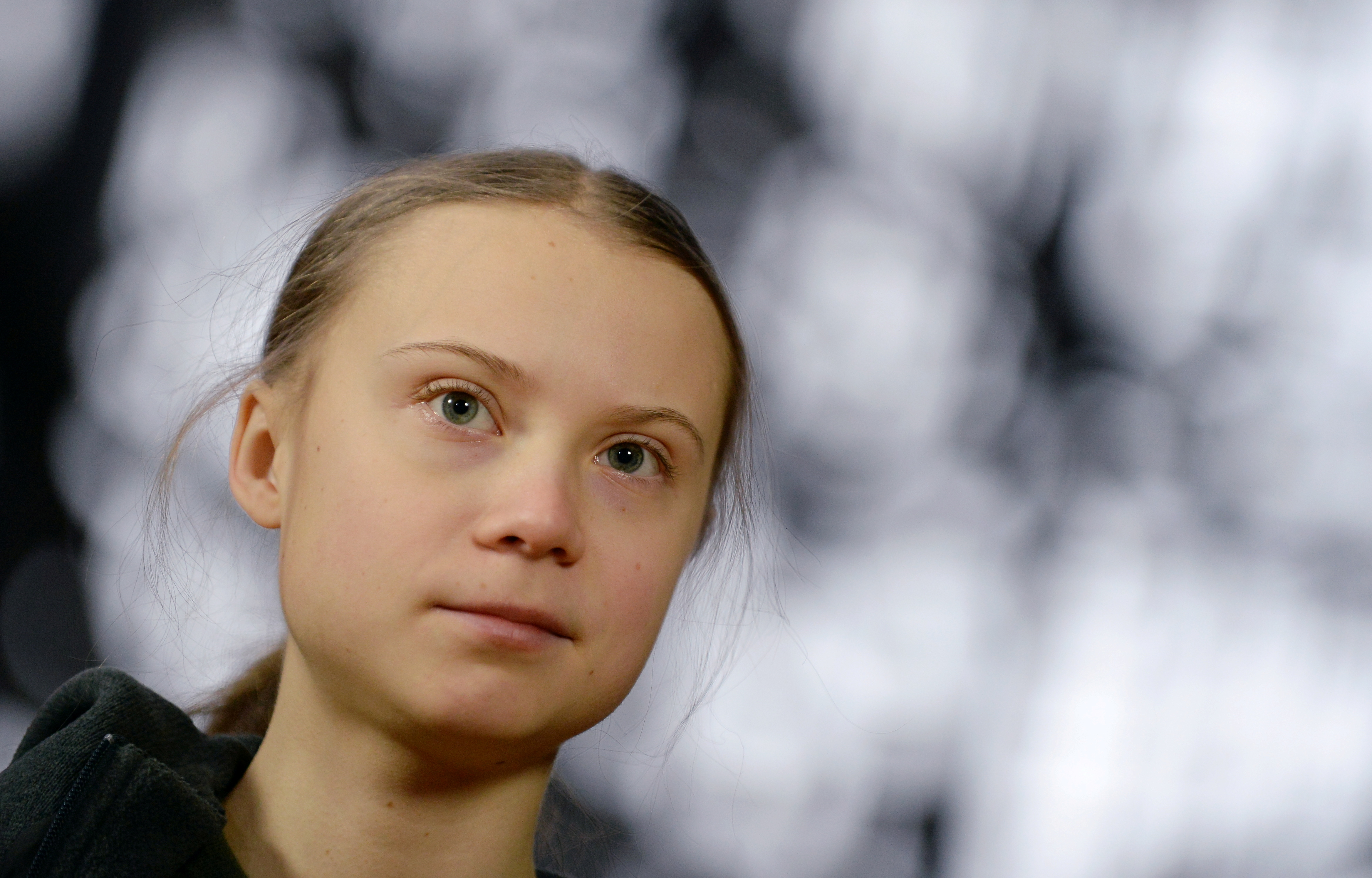 Swedish climate activist Greta Thunberg talks to the media before meeting with EU environment ministers in Brussels, Belgium, March 5, 2020. REUTERS/Johanna Geron