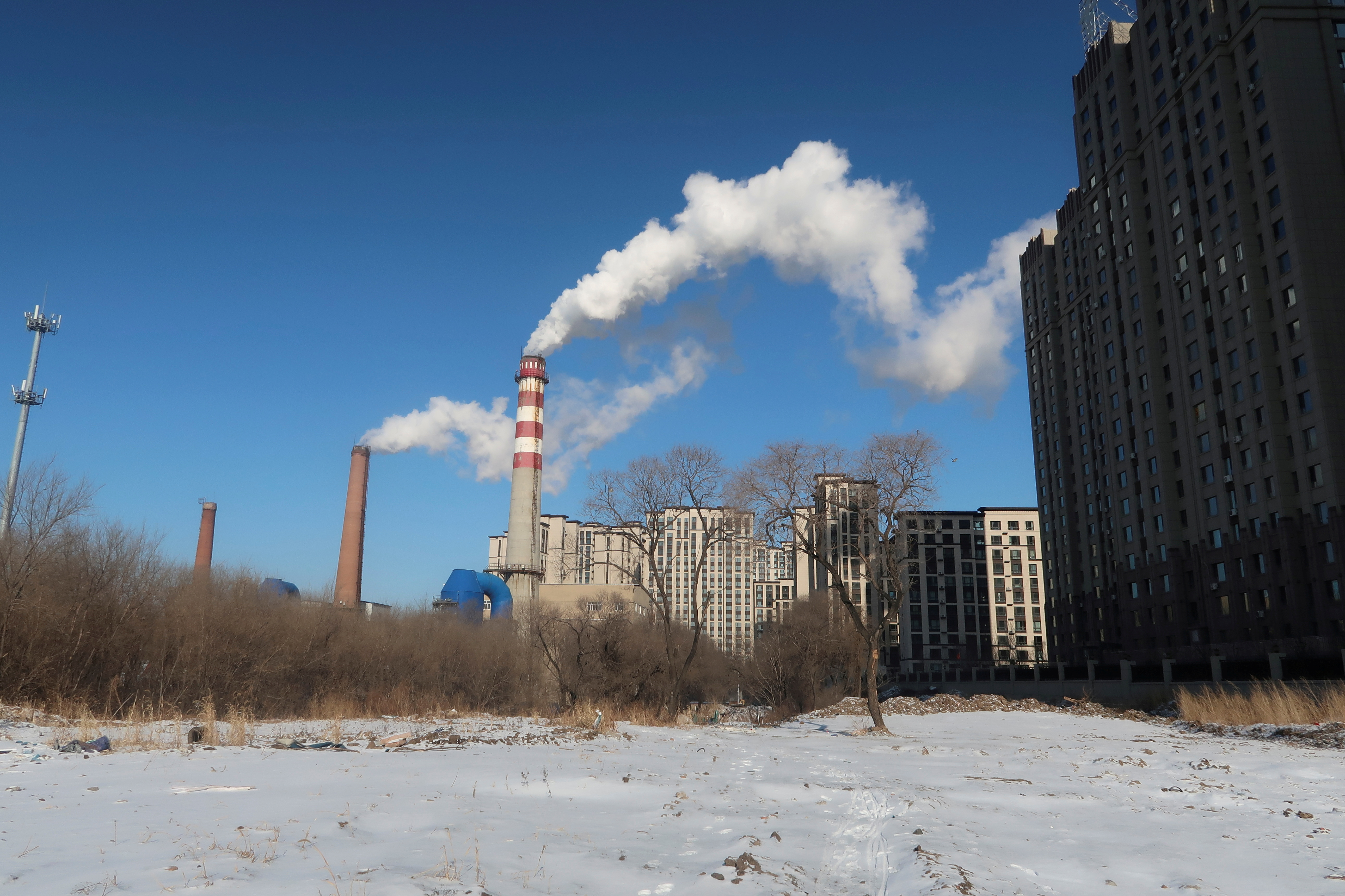 A coal-fired heating complex is seen behind the ground covered by snow in Harbin, Heilongjiang province, China November 15, 2019. REUTERS/Muyu Xu