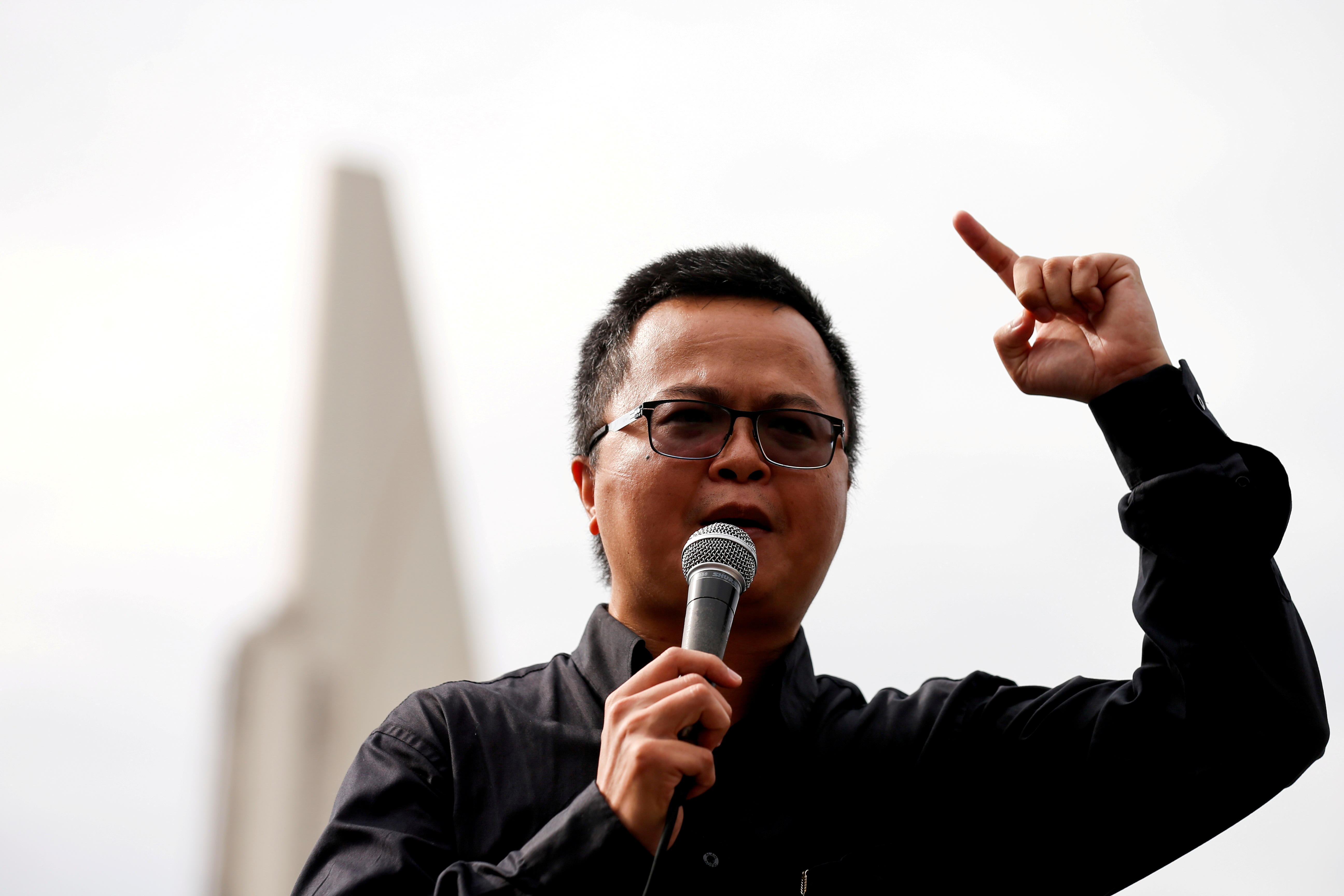 Human rights lawyer Arnon Nampa speaks during a Thai anti-government mass protest, on the 47th anniversary of the 1973 student uprising, in front of the Democracy monument, in Bangkok, Thailand October 14, 2020. REUTERS/Soe Zeya Tun/File Photo