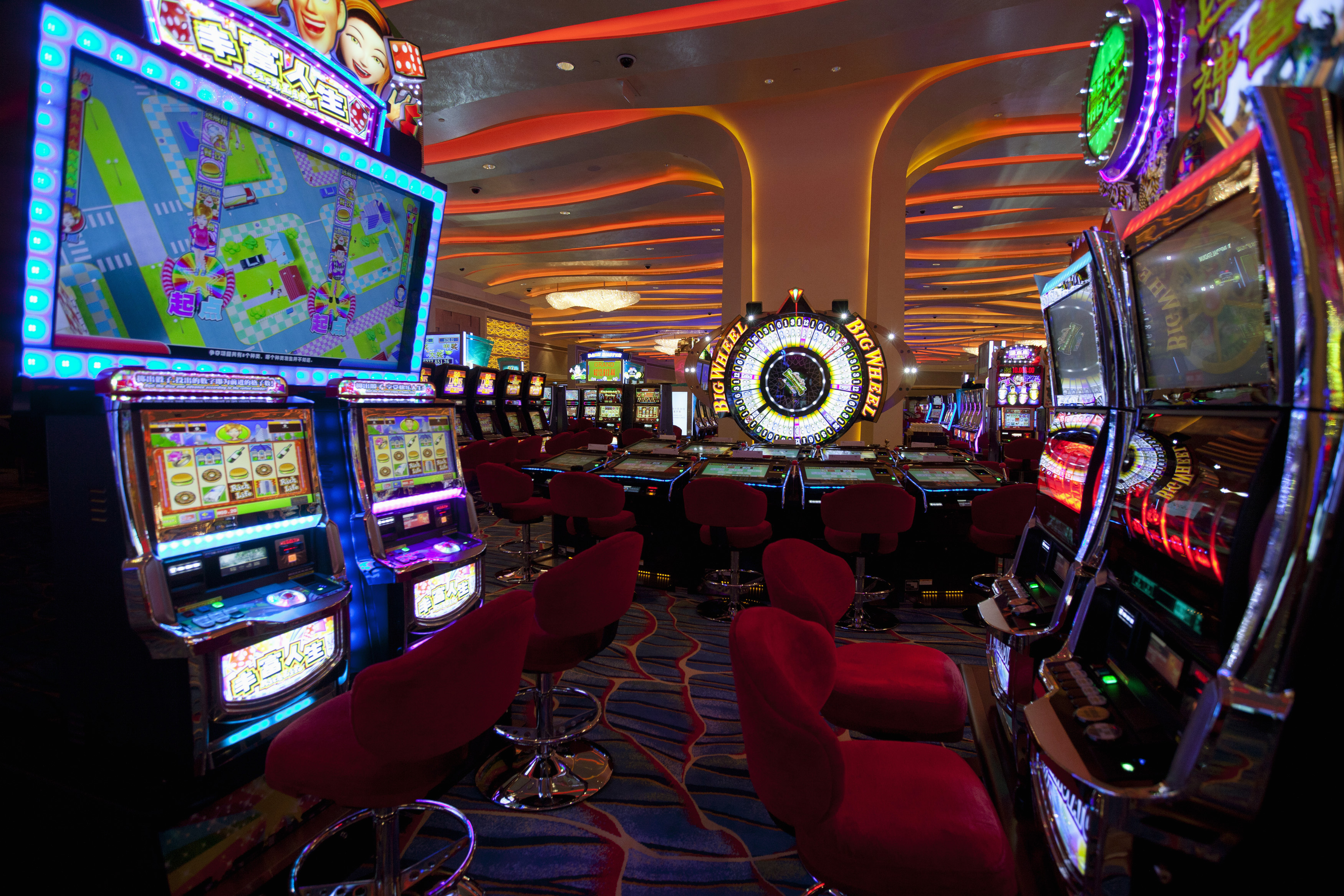 Gaming machines are seen inside a casino on the opening day of Sheraton Macao hotel at Sands Cotai Central in Macau September 20, 2012. REUTERS/Tyrone Siu