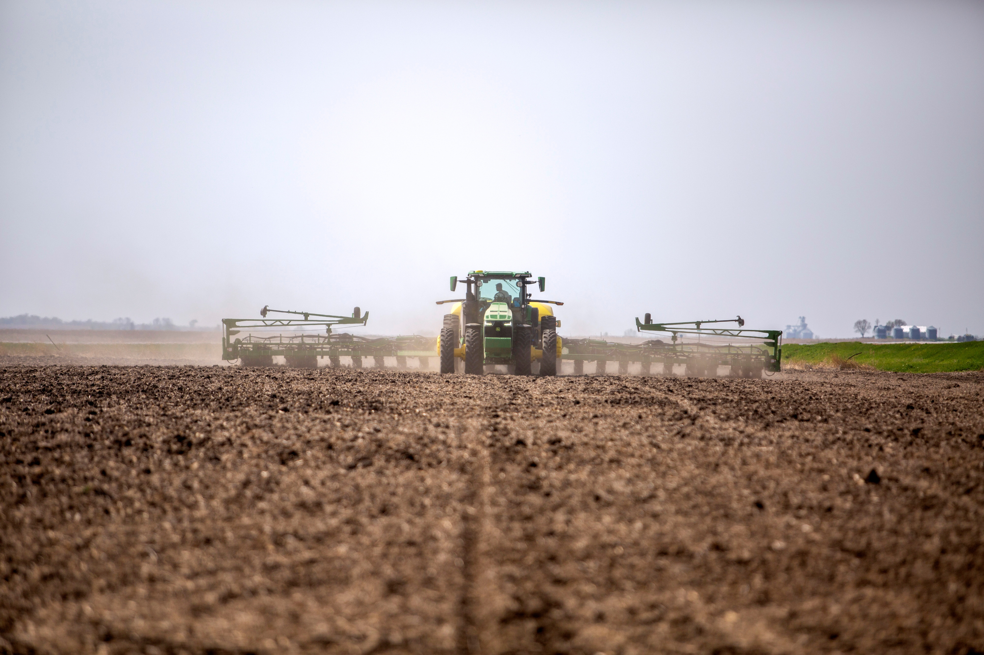 Chris Hays drives a new tractor and planter during spring planting at their farm in Malvern, Iowa, U.S., April 27, 2021. Picture taken April 27, 2021.   REUTERS/Rachel Mummey