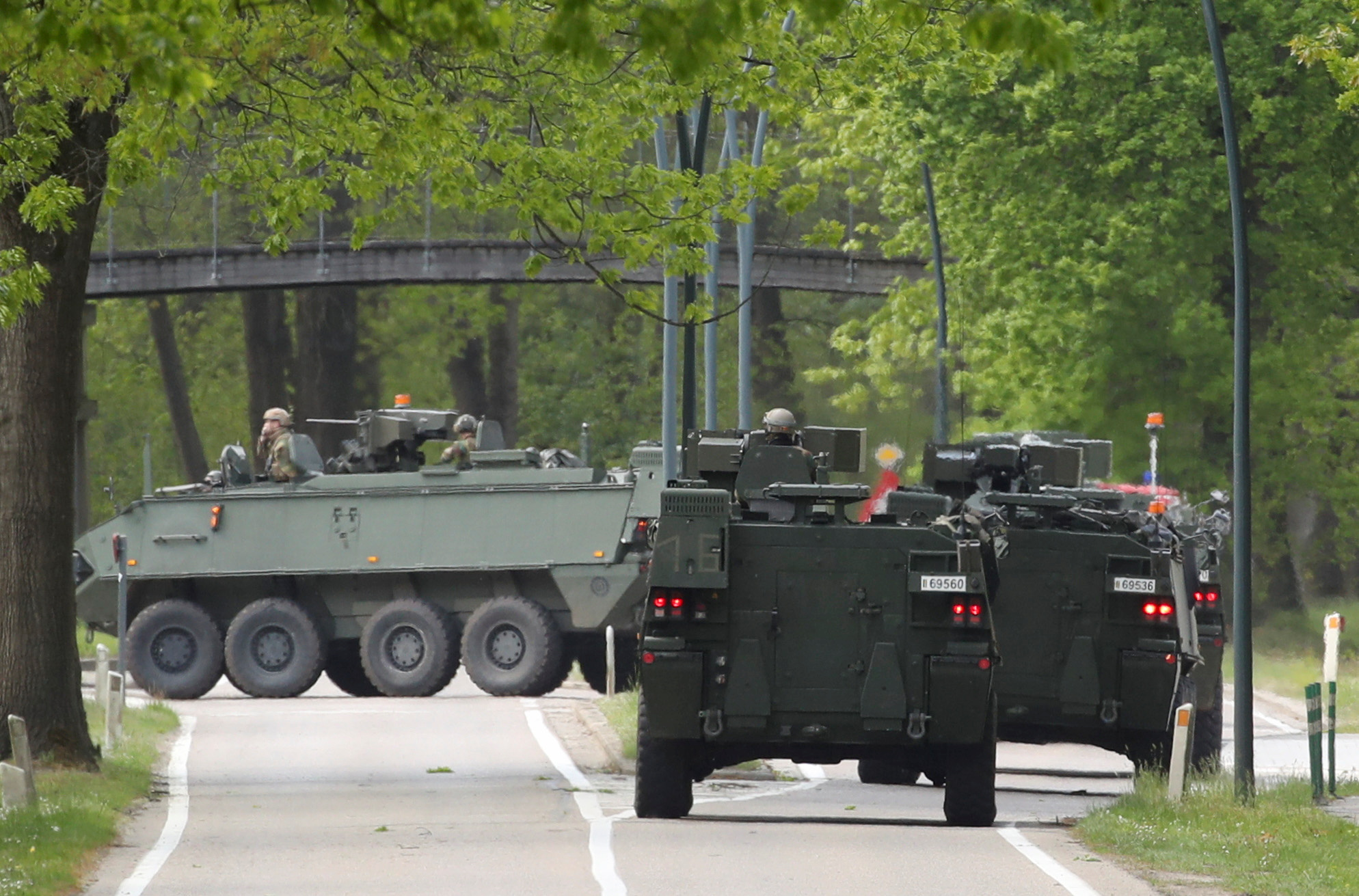 Belgian army members arrive in armoured vehicles at National Park Hoge Kempen while scouring to capture Belgian Jurgen Conings, a soldier who disappeared after threatening a virologist supportive of coronavirus disease (COVID-19) vaccines and coronavirus restrictions, in Maasmechelen, Belgium May 21, 2021. REUTERS/Yves Herman
