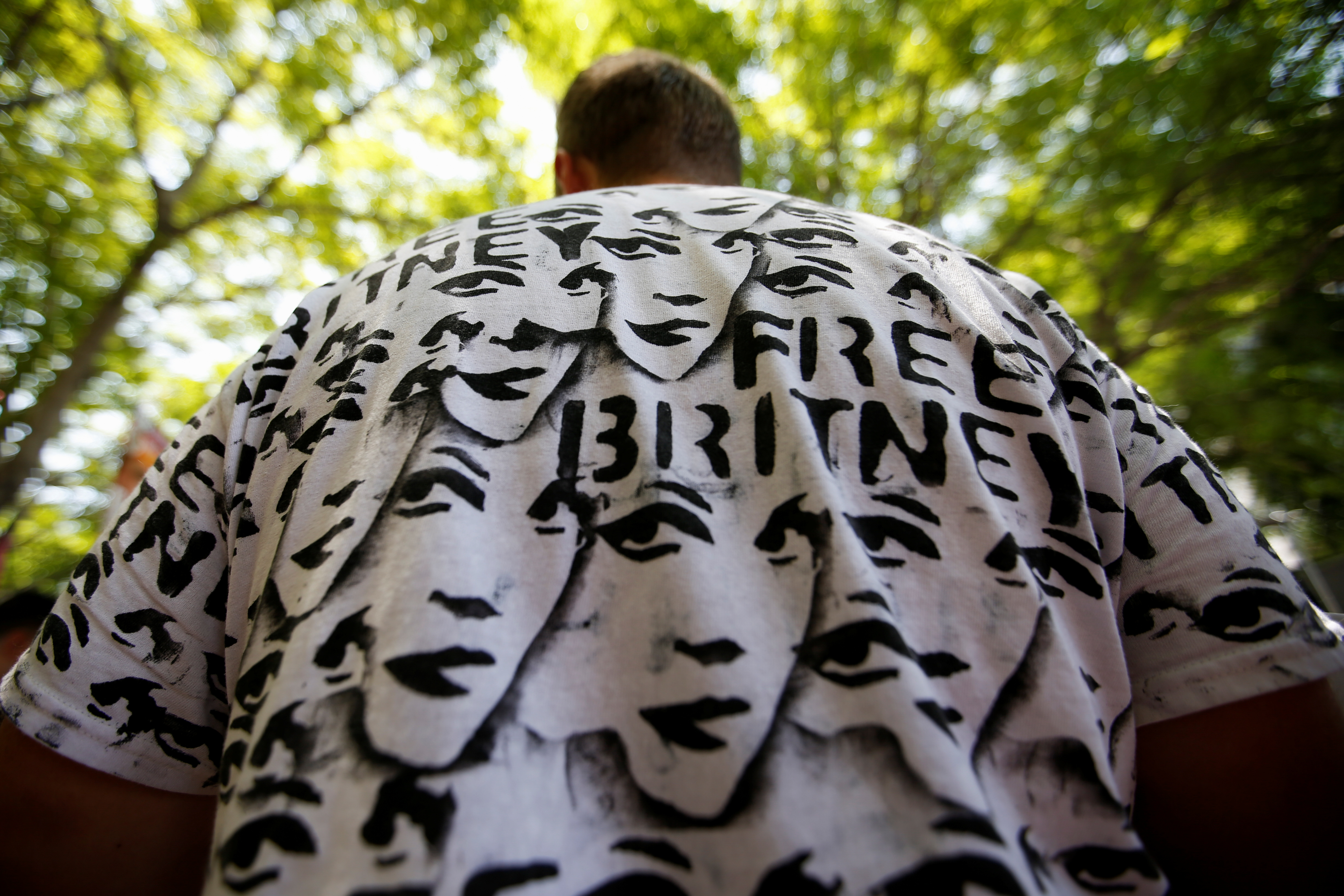 A demonstrator takes part in a protest in support of pop star Britney Spears on the day of a conservatorship case hearing at Stanley Mosk Courthouse in Los Angeles, California, U.S., July 14, 2021.  REUTERS/Mario Anzuoni
