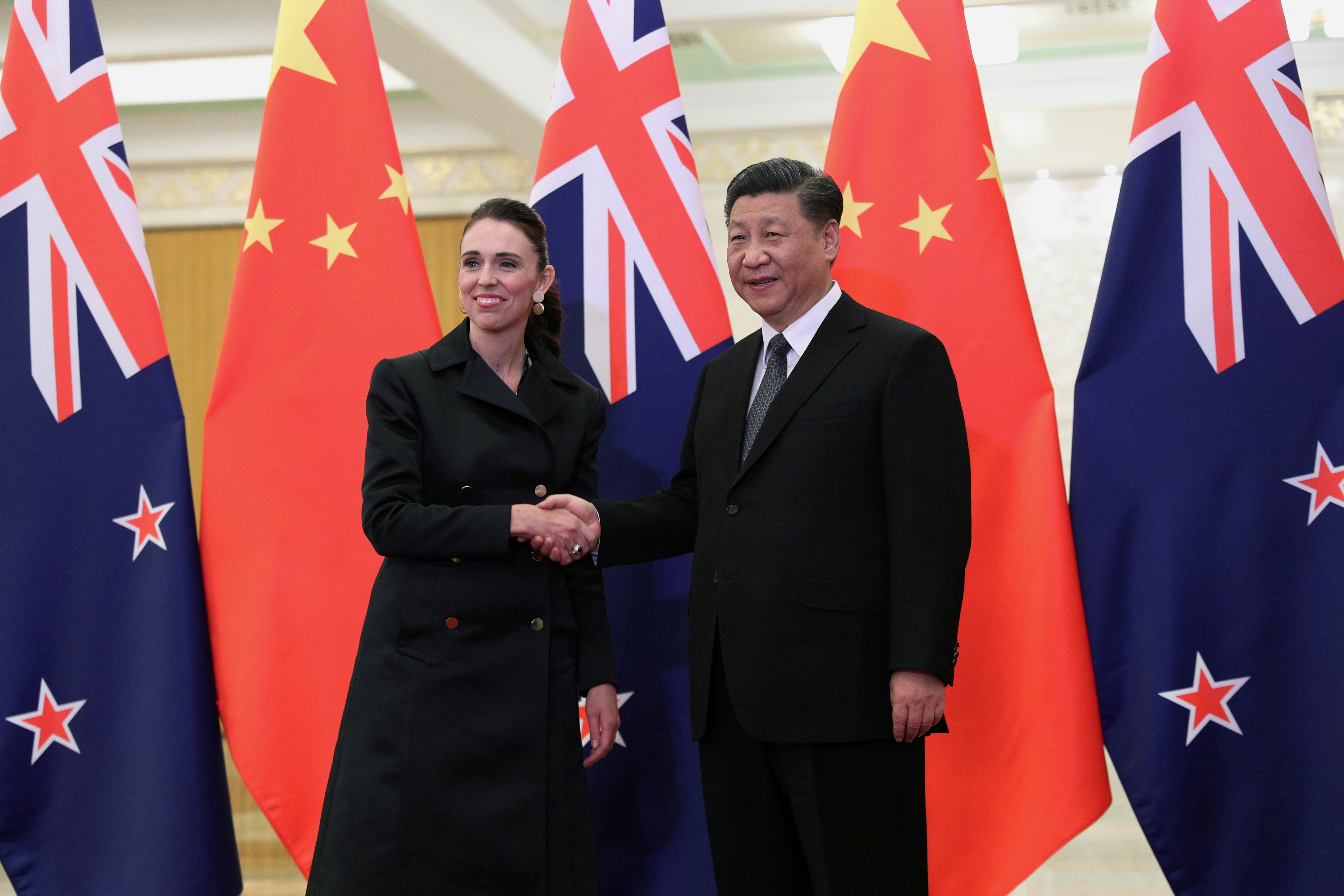 Chinese President Xi Jinping and New Zealand Prime Minister Jacinda Ardern shake hands before the meeting at the Great Hall of the People in Beijing, China April 1, 2019. Kenzaburo Fukuhara/KYODONEWS/Pool via REUTERS/