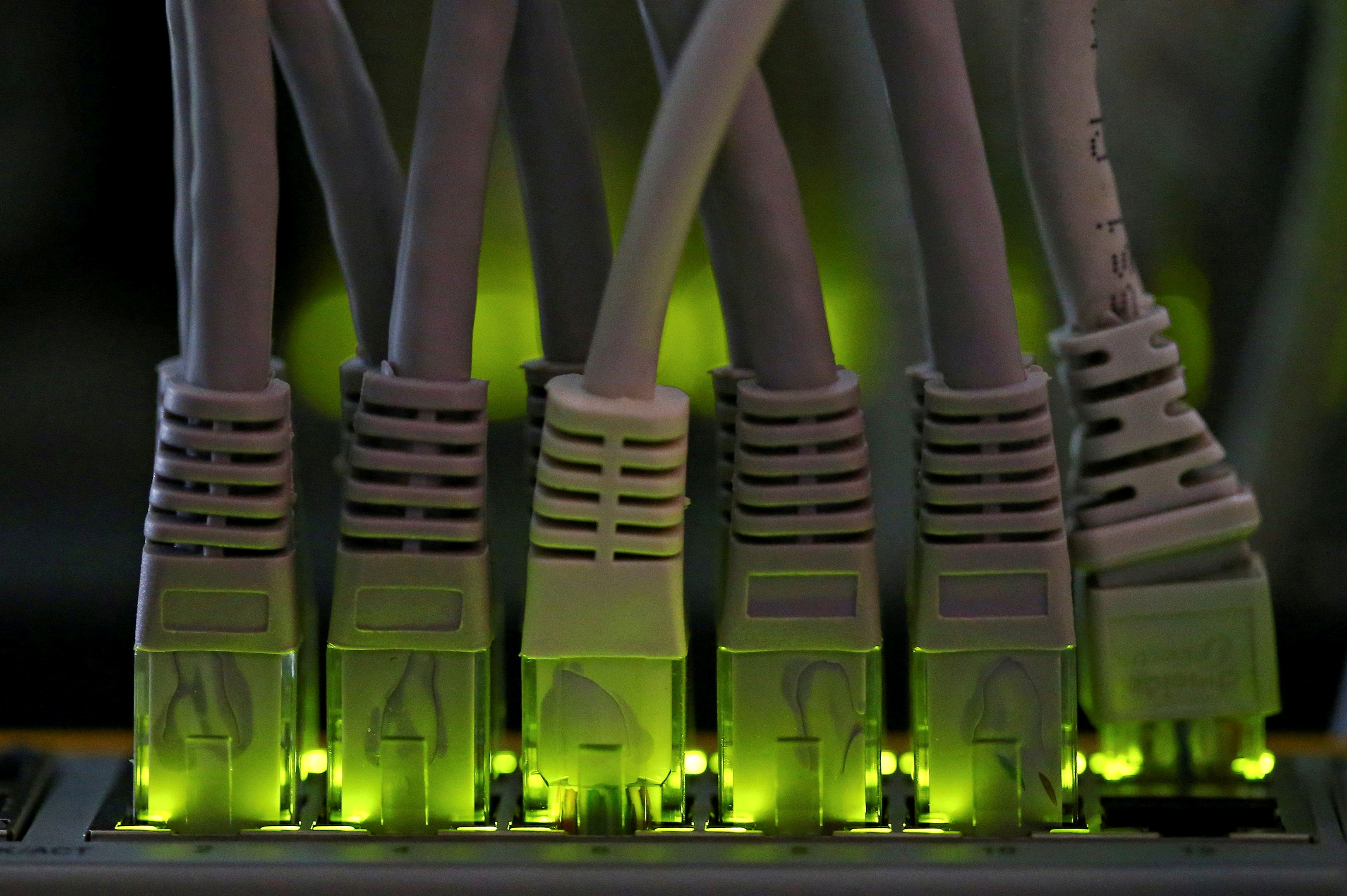 LAN network cables plugged into a Bitcoin mining computer server are pictured in Bitminer Factory in Florence, Italy, April 6, 2018. REUTERS/Alessandro Bianchi/File Photo/File Photo