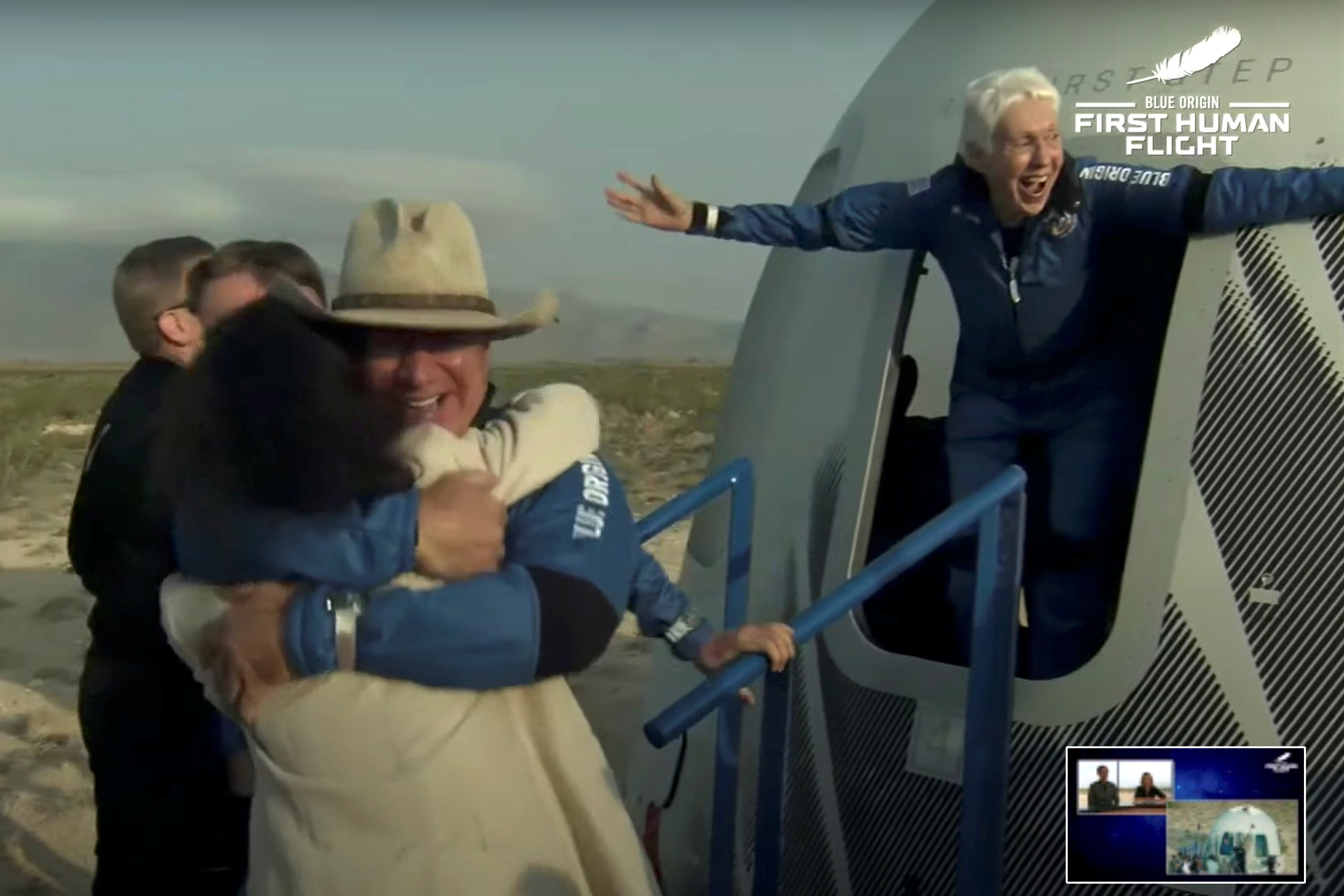 Billionaire businessman Jeff Bezos and pioneering female aviator Wally Funk emerge from their capsule after their flight aboard Blue Origin's New Shepard rocket on the world's first unpiloted suborbital flight near Van Horn, Texas, U.S., July 20, 2021 in a still image from video.  Blue Origin/Handout via REUTERS.