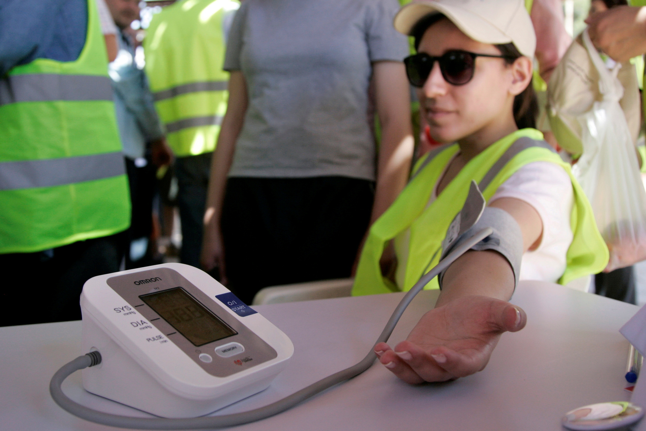 FILE PHOTO: A woman has her blood pressure taken at a World Hypertension Day event in Amman May 14, 2010. REUTERS/Muhammad Hamed/File Photo/File Photo