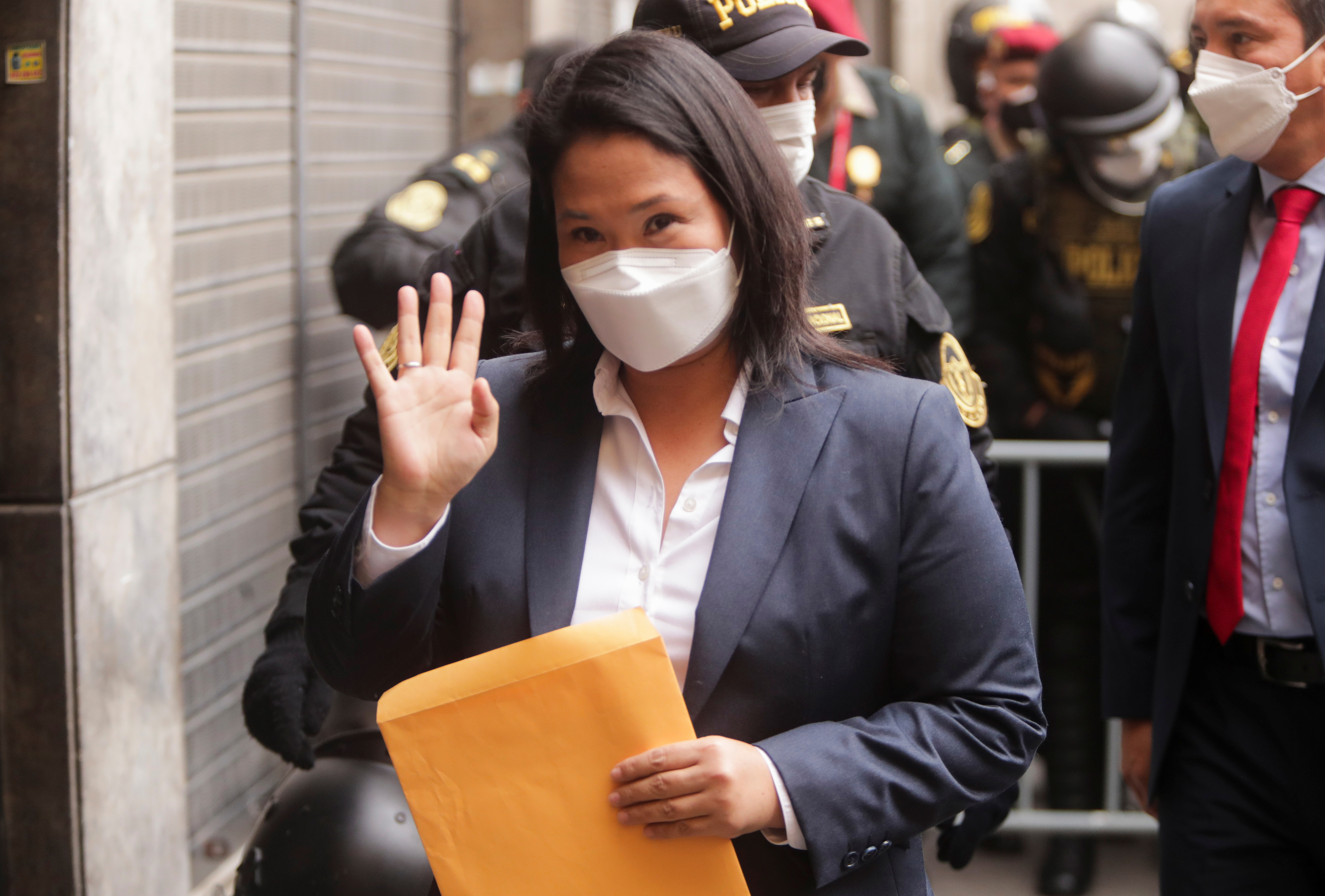 Peru's presidential candidate Keiko Fujimori gestures to the media before delivering a letter requesting an international audit of the vote to the government palace, in Lima, Peru June 28, 2021. REUTERS/Sebastian Castaneda