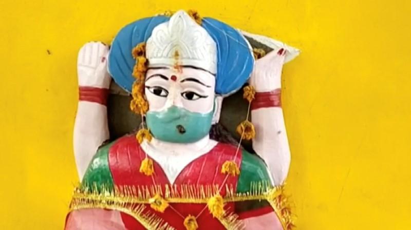 An idol of 'Corona Mata' (Mother Corona) is seen at a temple in Pratapgarh, amid the coronavirus disease (COVID-19) pandemic, Uttar Pradesh, India June 11, 2021, in this still image taken from video. ANI/REUTERS TV/VIA REUTERS
