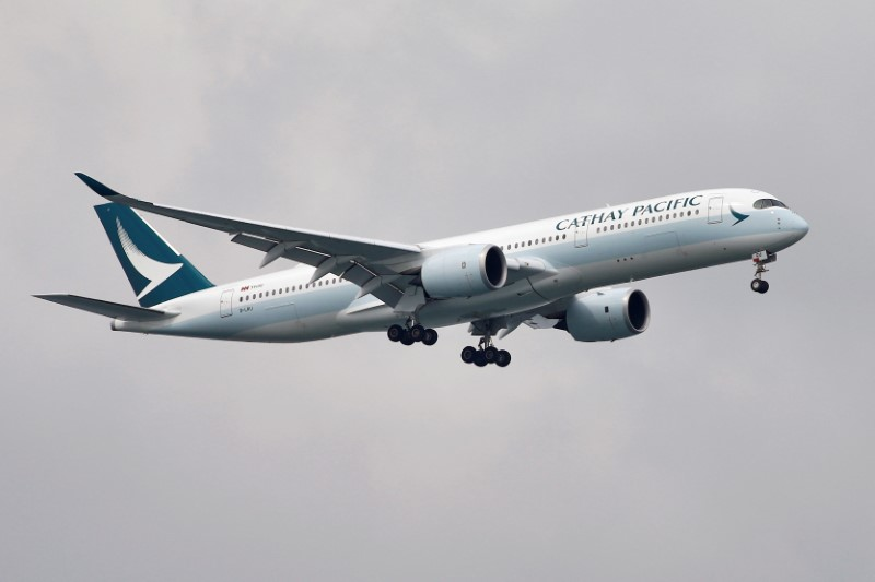 A Cathay Pacific Airways Airbus A350-900 airplane approaches to land at Changi International Airport in Singapore June 10, 2018.  REUTERS/Tim Chong/File Photo