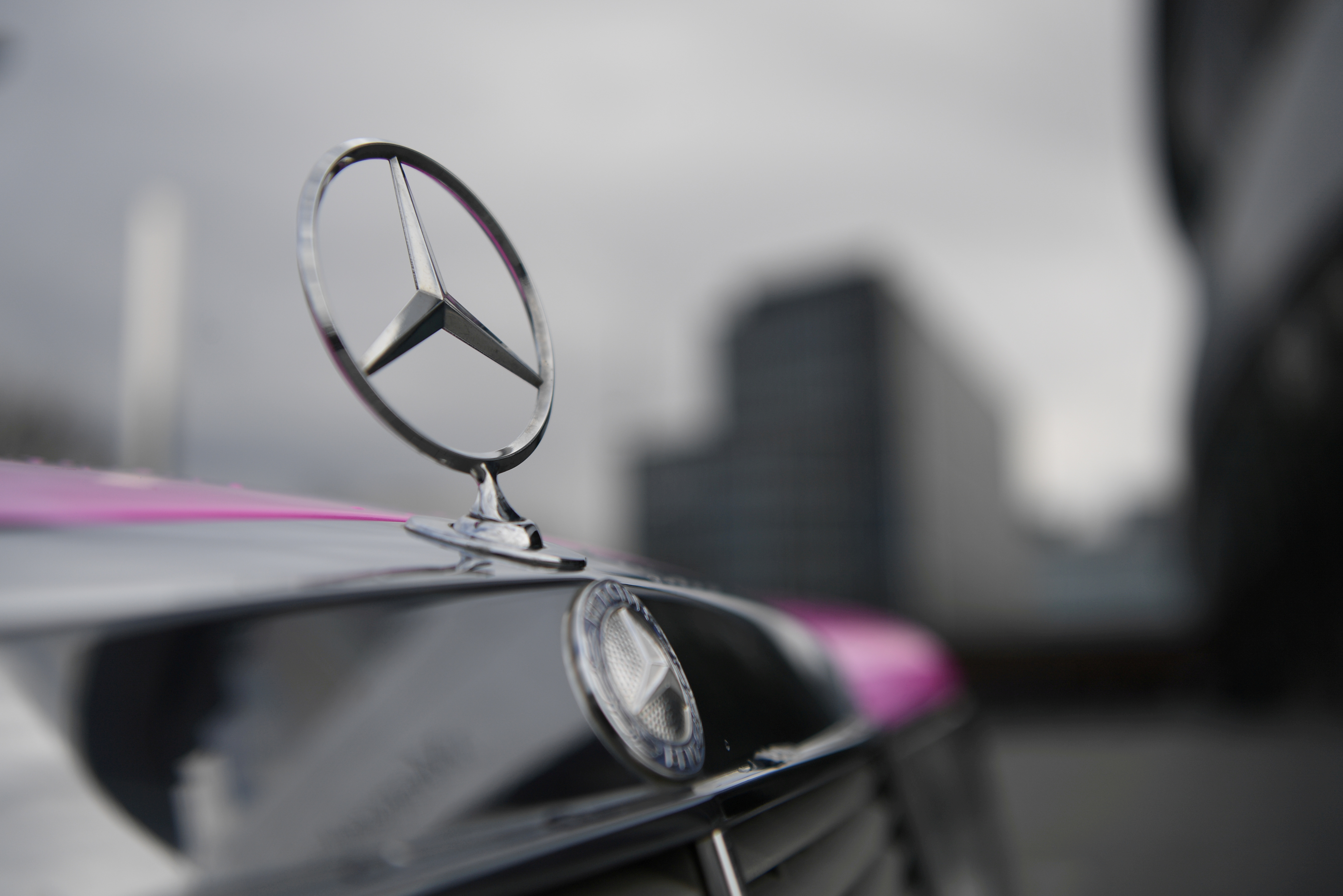 The Mercedes-Benz logo is seen on a car in front of the Mercedes-Benz Museum in Stuttgart, Germany February 11, 2020. REUTERS/Andreas Gebert