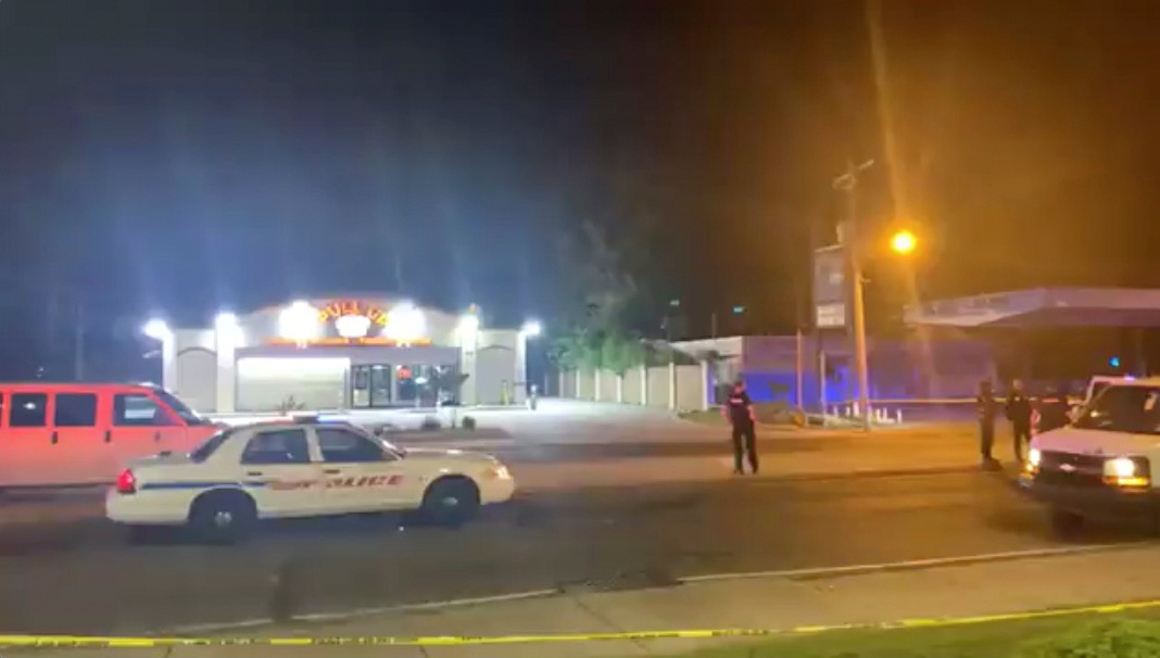 Police personnel and their vehicles are seen near the scene in the aftermath of a drive-by shooting at a liquor store in Shreveport, Louisiana, U.S., April 18, 2021, in this still image from video obtained via social media. LOVE SHREVEPORT-BOSSIER via REUTERS    ATTENTION EDITORS - NO RESALES. NO ARCHIVES. THIS IMAGE HAS BEEN SUPPLIED BY A THIRD PARTY. MANDATORY CREDIT.