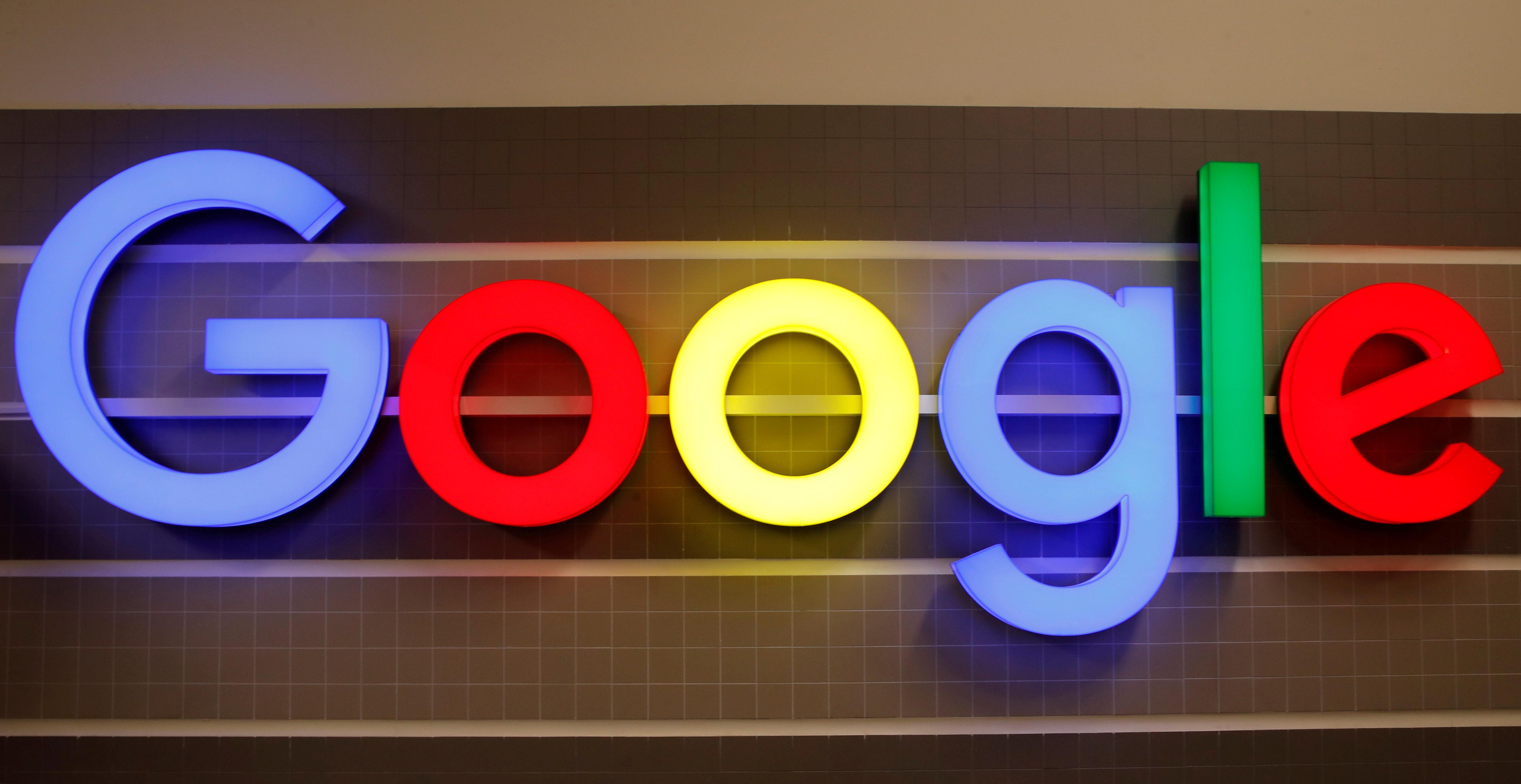 An illuminated Google logo is seen inside an office building in Zurich, Switzerland December 5, 2018. REUTERS/Arnd Wiegmann/File Photo
