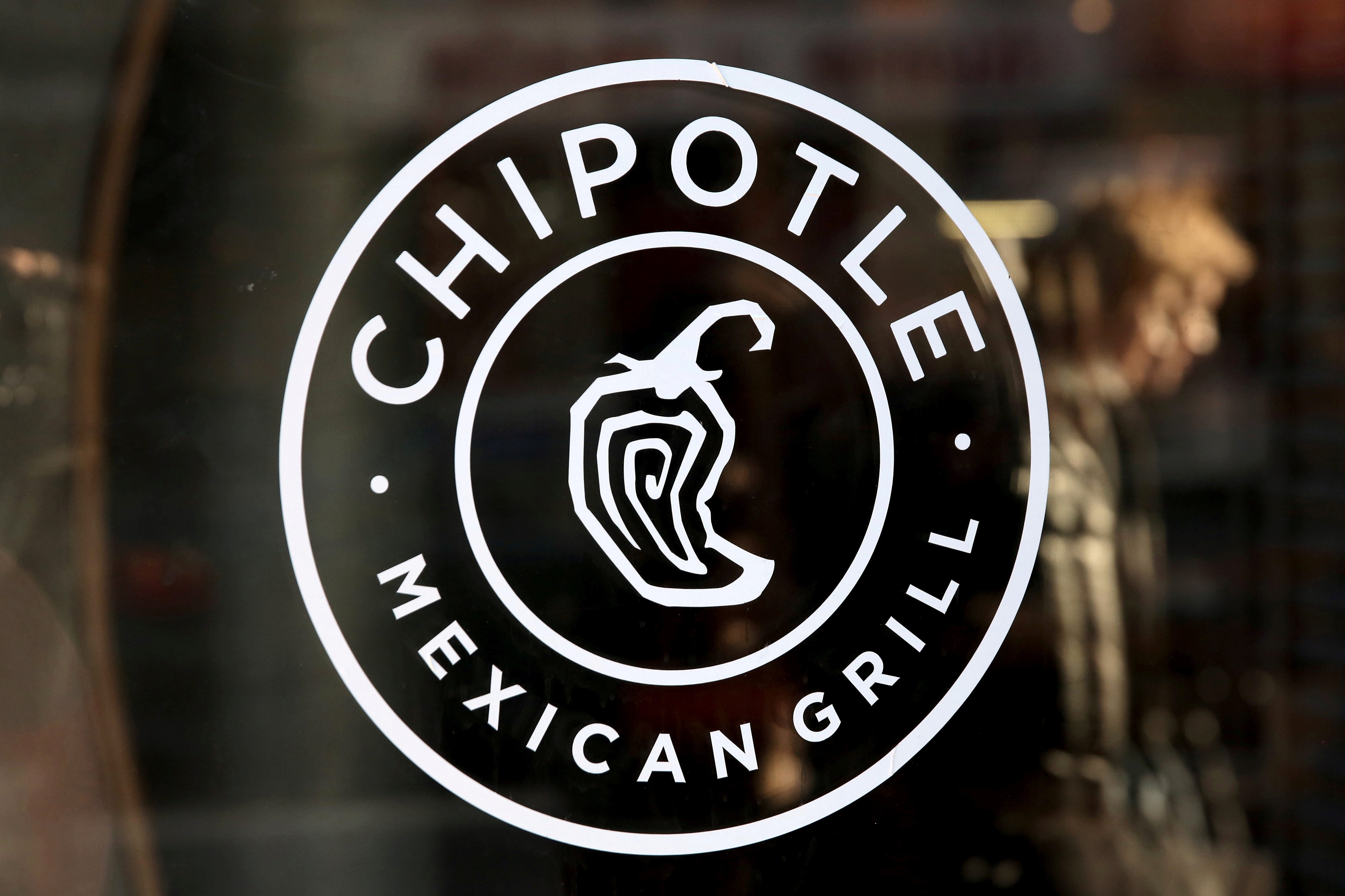 A logo of Chipotle Mexican Grill is seen on a store entrance in Manhattan, New York November 23, 2015. REUTERS/Andrew Kelly/File Photo