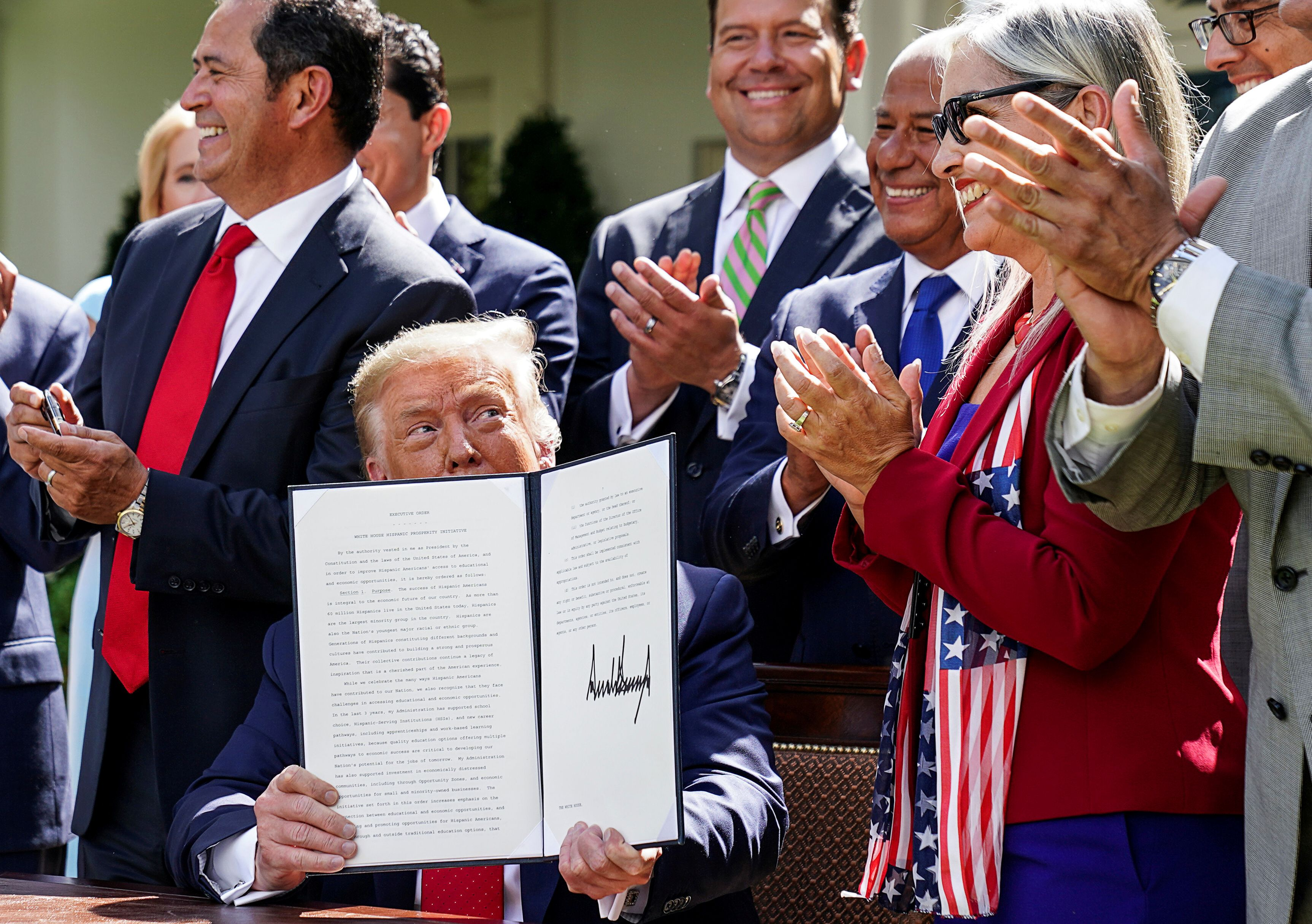 U.S. President Donald Trump holds an Executive Order during a signing ceremony in the Rose Garden at the White House in Washington, U.S., July 9, 2020. REUTERS/Kevin Lamarque/File Photo