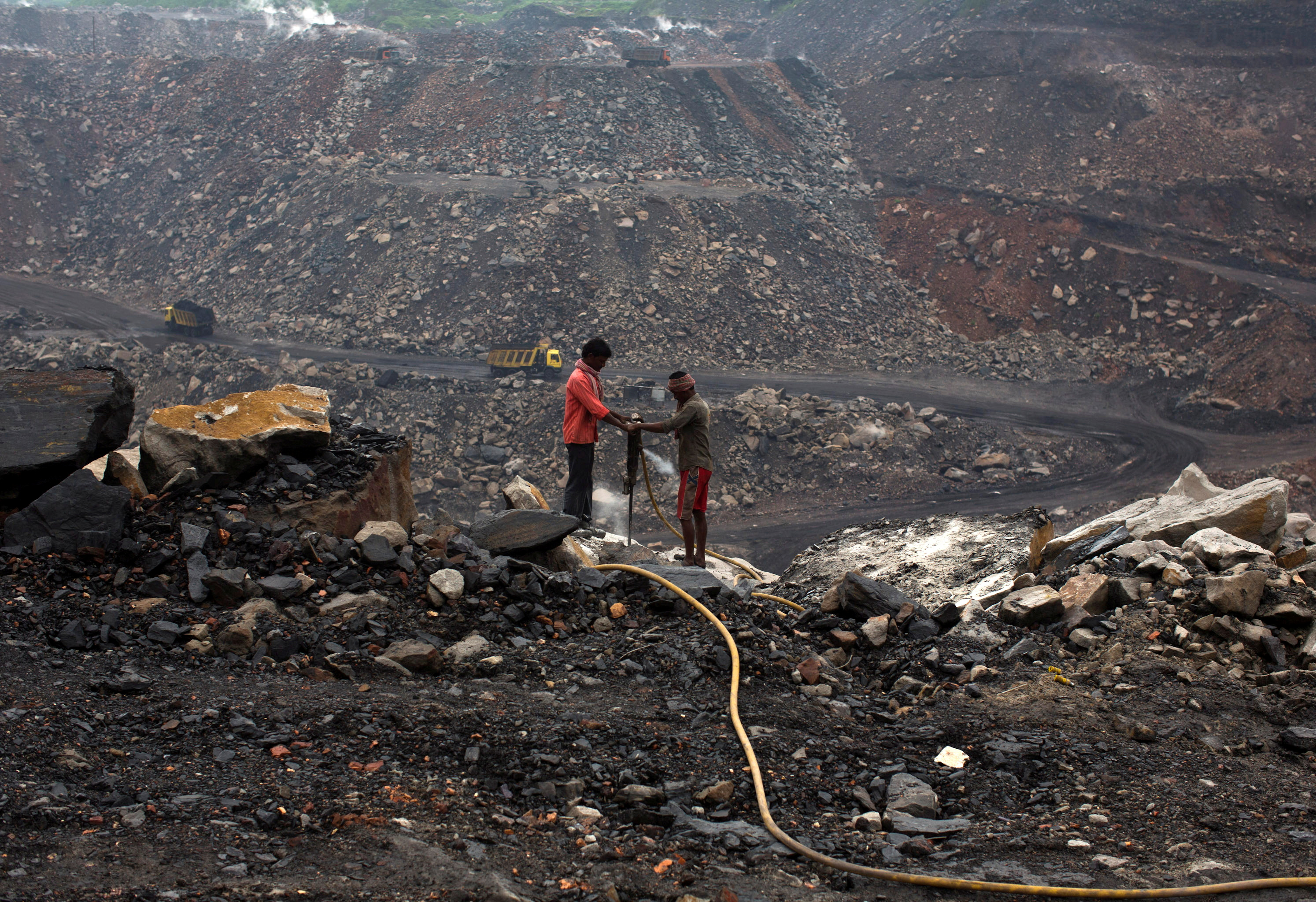 Workers drill at an open cast coal field at Dhanbad district in the eastern Indian state of Jharkhand September 18, 2012. REUTERS/Ahmad Masood/File Photo/File Photo