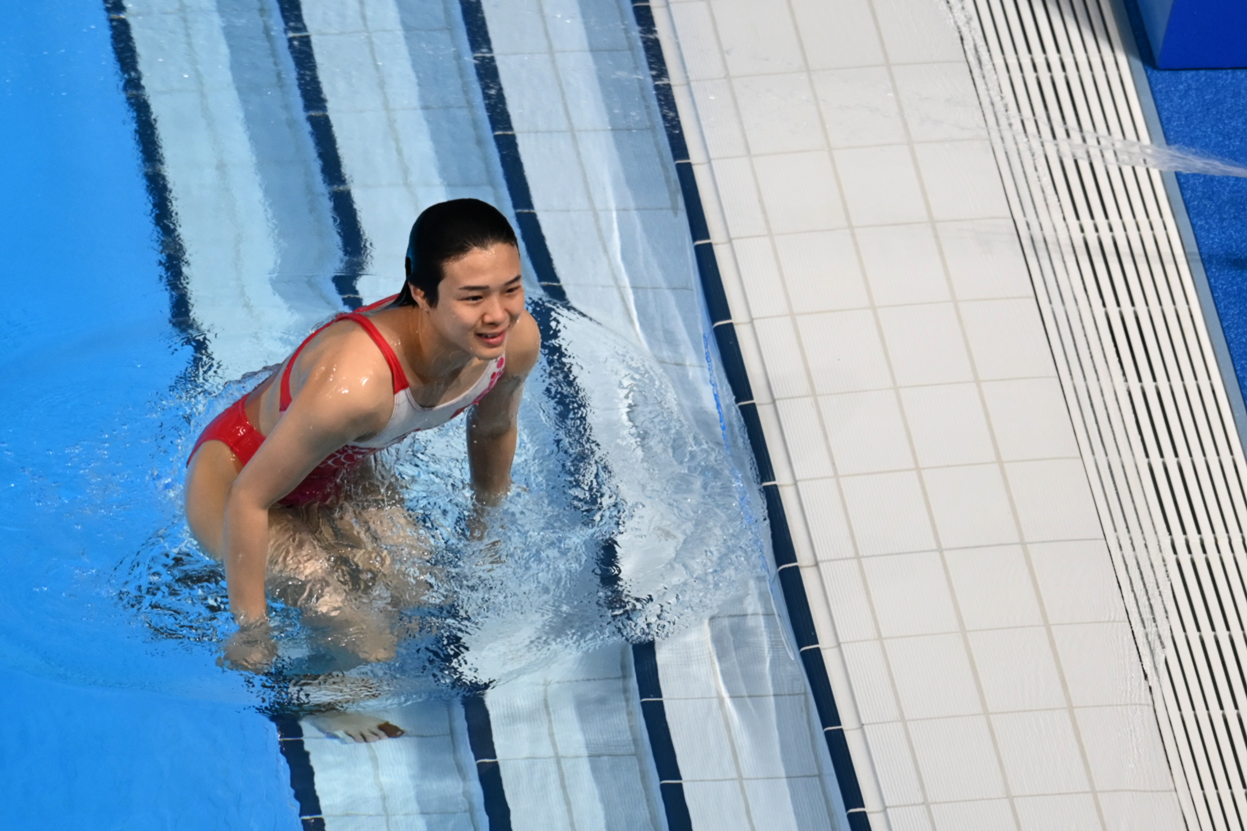 Tokyo 2020 Olympics - Diving - Women's 3m Springboard - Final - Tokyo Aquatics Centre, Tokyo, Japan - August 1, 2021. Tingmao Shi of China leaves the pool after the last dive REUTERS/Annegret Hilse