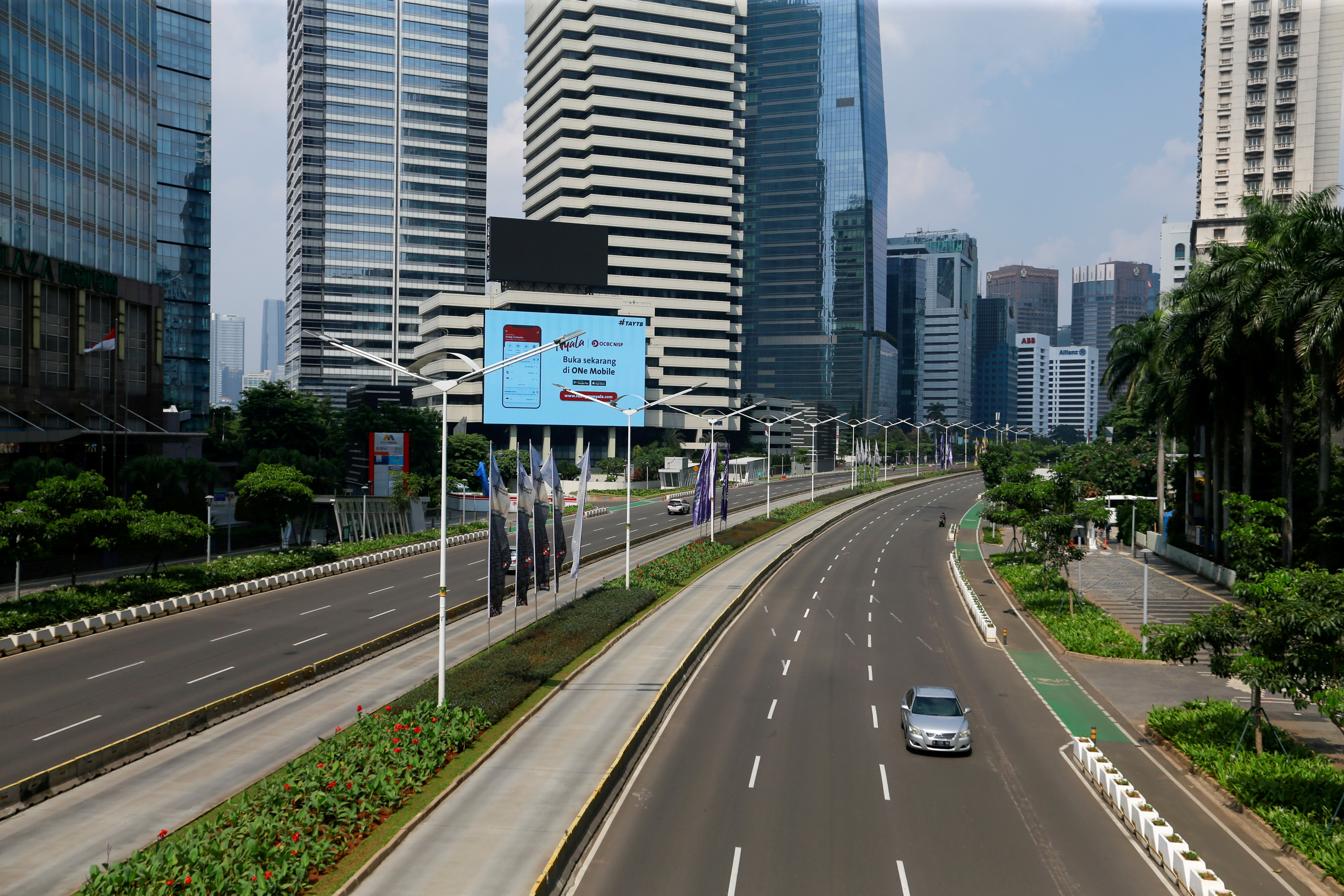 A general view shows a deserted main road during the imposition of large-scale social restrictions by the government to prevent the spread of the coronavirus disease (COVID-19) in Jakarta, Indonesia, July 3, 2021. REUTERS/Ajeng Dinar Ulfiana/File Photo