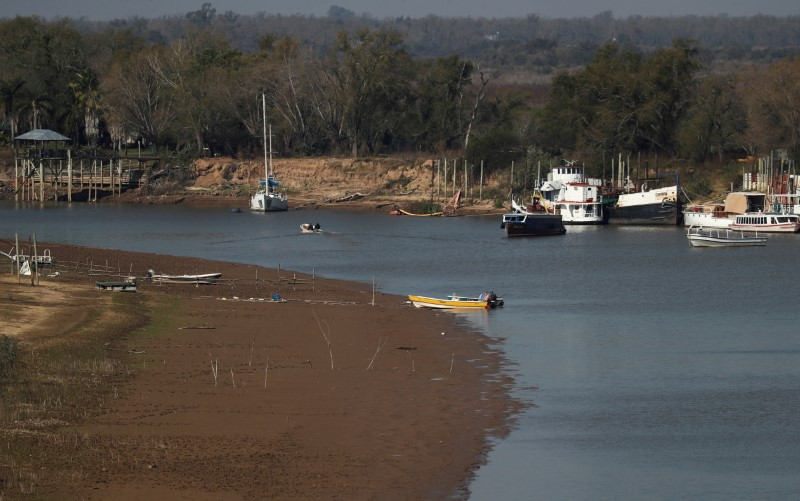 Boats are seen on the shore of the Parana River, in Rosario, Argentina  July 8, 2021. The lack of rain in Brazil, where the river originates, has brought water levels down in Argentina, forcing cargo ships to reduce the amount of grains that are loaded for export. REUTERS/Agustin Marcarian/