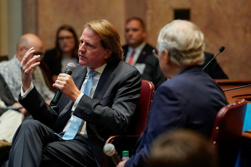 Former White House counsel Don McGahn sits with Senate Majority Leader Mitch McConnell while speaking to a gathering of the Federalist Society at the State Capitol in Frankfort, Kentucky, U.S. October 7, 2019.  REUTERS/Bryan Woolston - RC1121CC8830