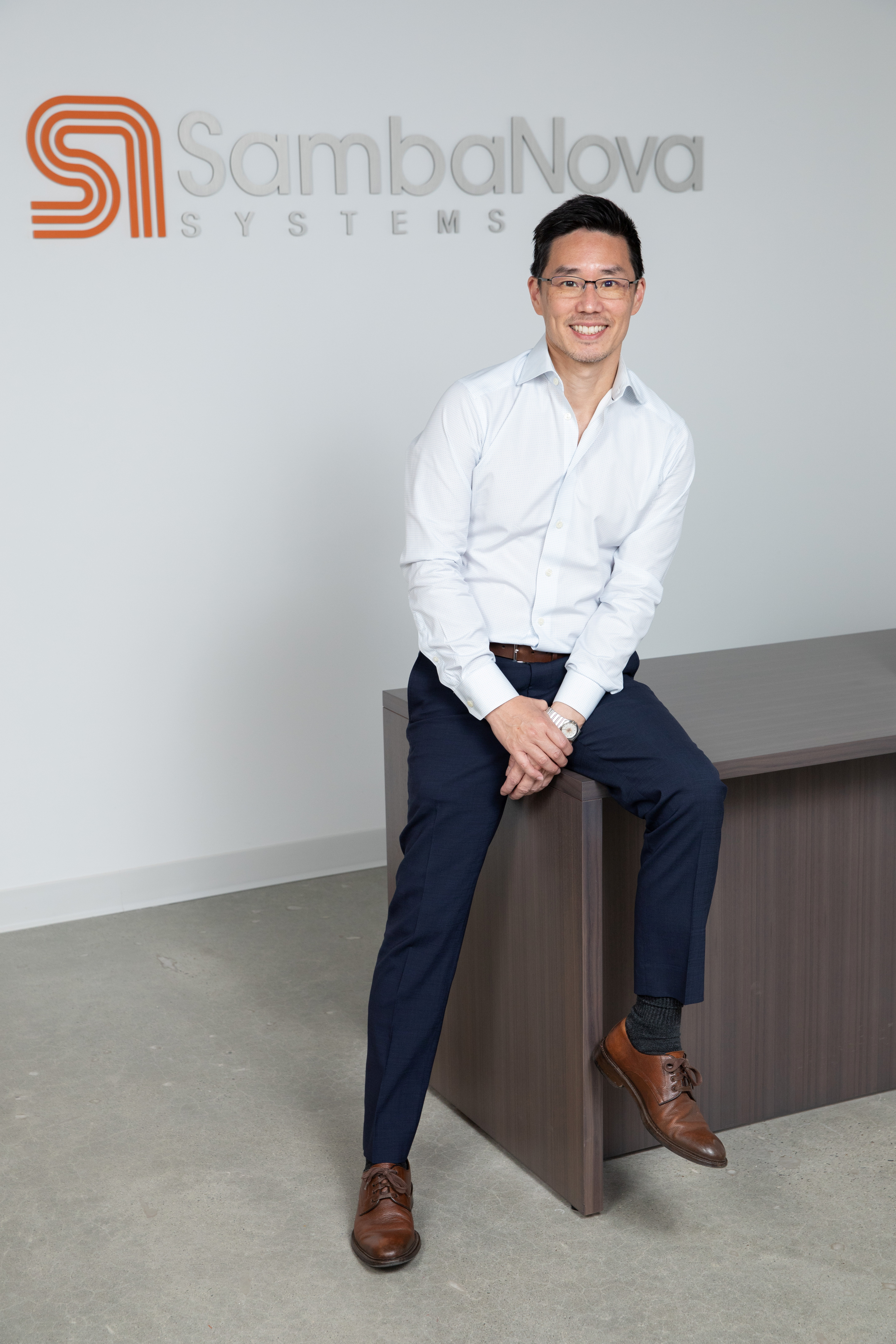 Rodrigo Liang, SambaNova Systems co-founder and CEO, poses in front of the company logo in Palo Alto, U.S. in this undated handout photo. SambaNova makes semiconductors for artificial intelligence computation work and announced it raised $676 million in its latest funding round. CHRISTOPHE TESTI/Creative Shot Photography/Handout via REUTERS  THIS IMAGE HAS BEEN SUPPLIED BY A THIRD PARTY. NO RESALES. NO ARCHIVES