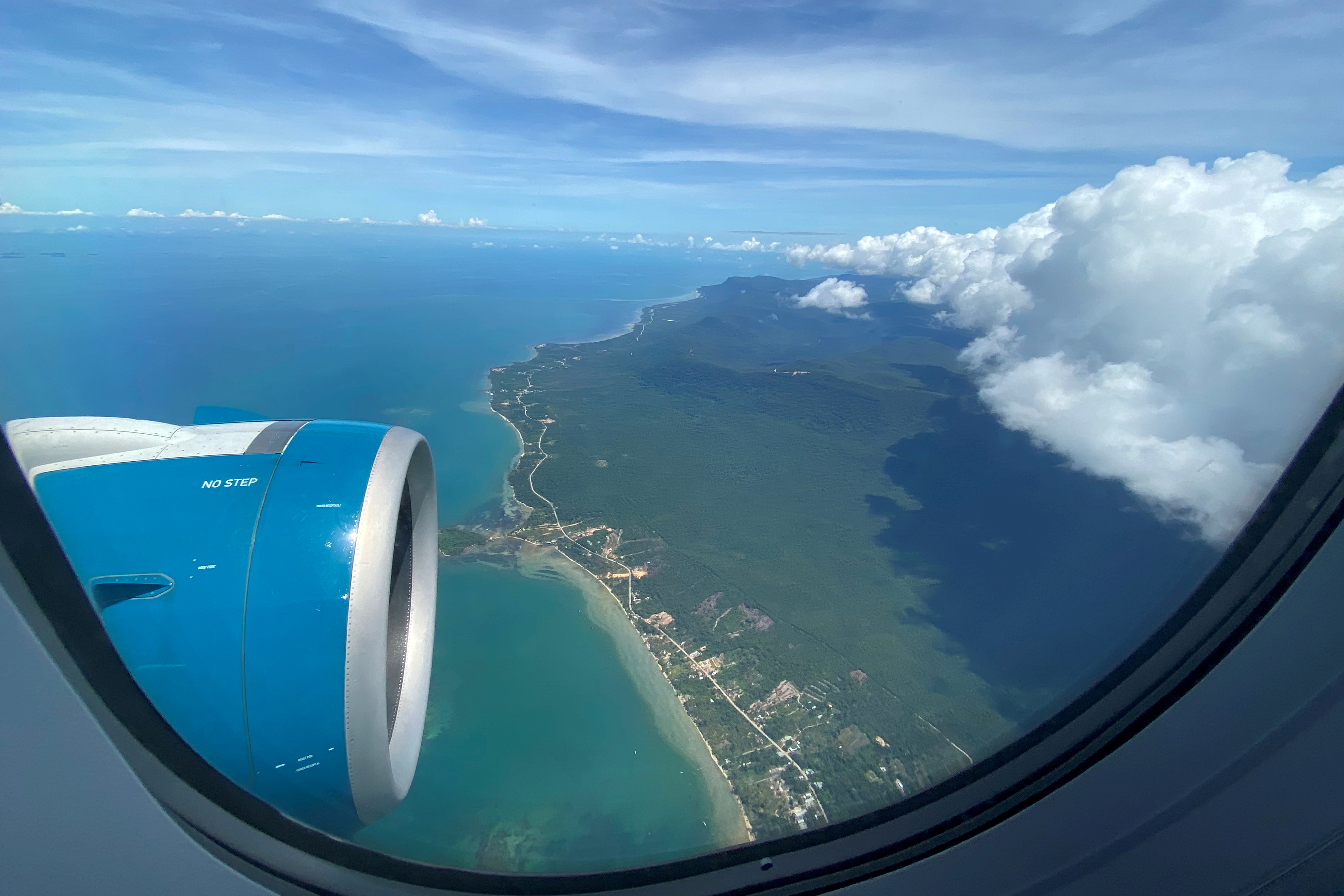 Phu Quoc resort island is seen via the window of an airplane after the Vietnamese government eased the lockdown following the coronavirus disease (COVID-19) outbreak, Phu Quoc Island, Vietnam May 8, 2020. Picture taken May 8, 2020. REUTERS/James Pearson