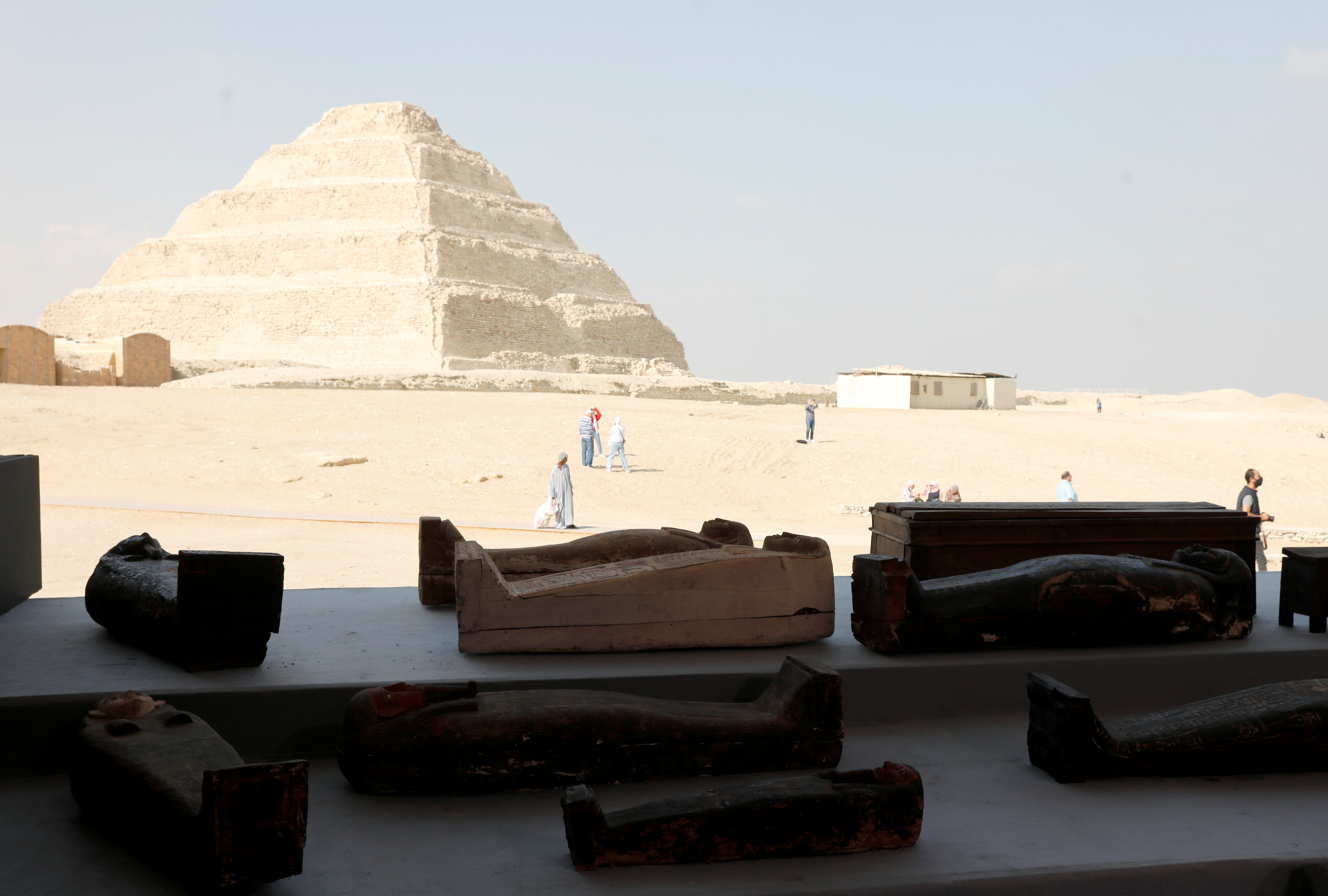 Sarcophaguses that are around 2500 years old, from the newly discovered burial site near Egypt's Saqqara necropolis, are seen during a presentation in Giza, Egypt November 14, 2020. REUTERS/Mohamed Abd El Ghany/File Photo