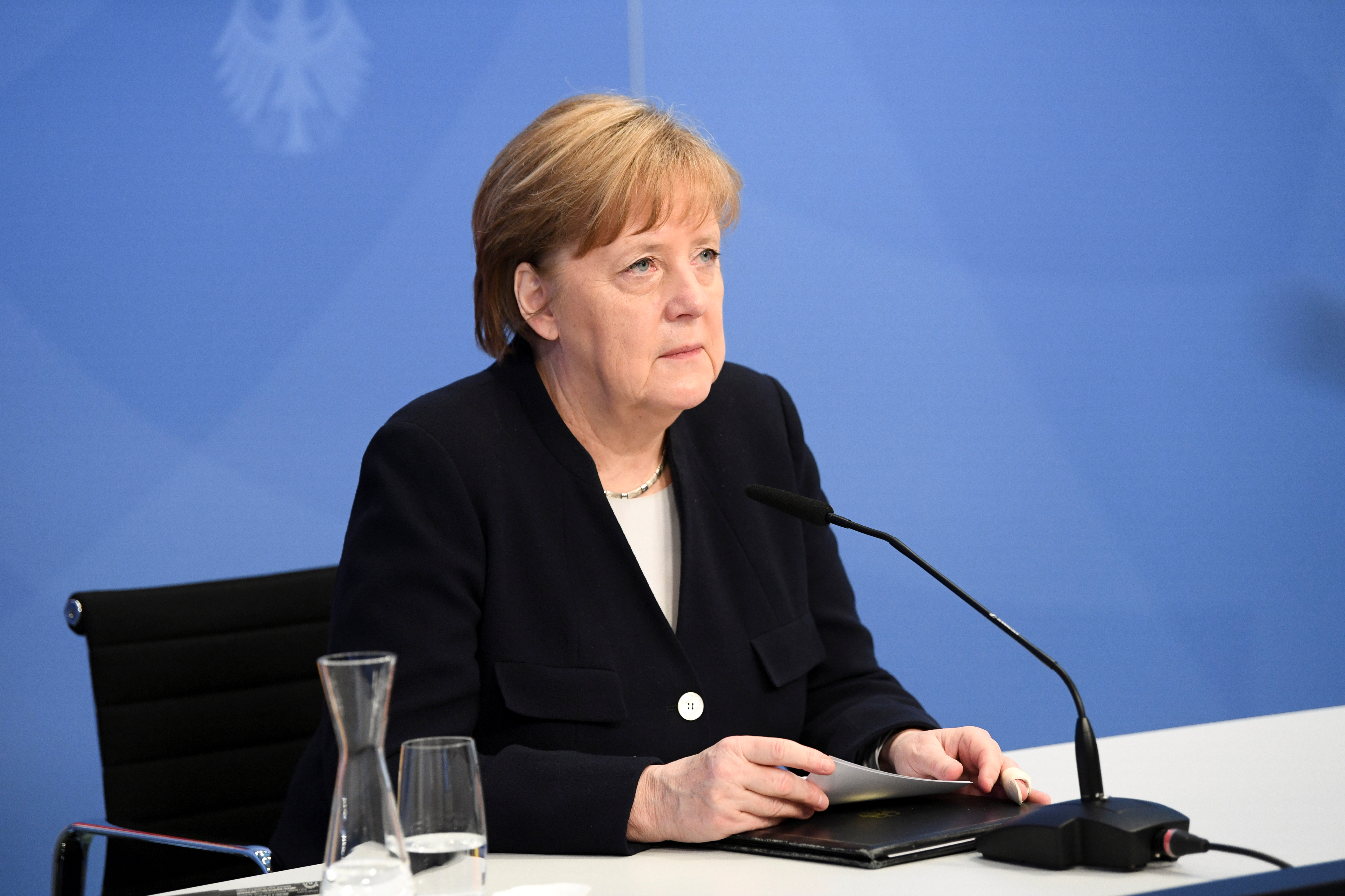 German Chancellor Angela Merkel sits down to attend a virtual event with Dutch Prime Minister Mark Rutte (not pictured) marking Liberation Day, the end of the occupation by Nazi Germany during World War Two, at the Chancellery in Berlin, Germany May 5, 2021. REUTERS/Annegret Hilse/Pool