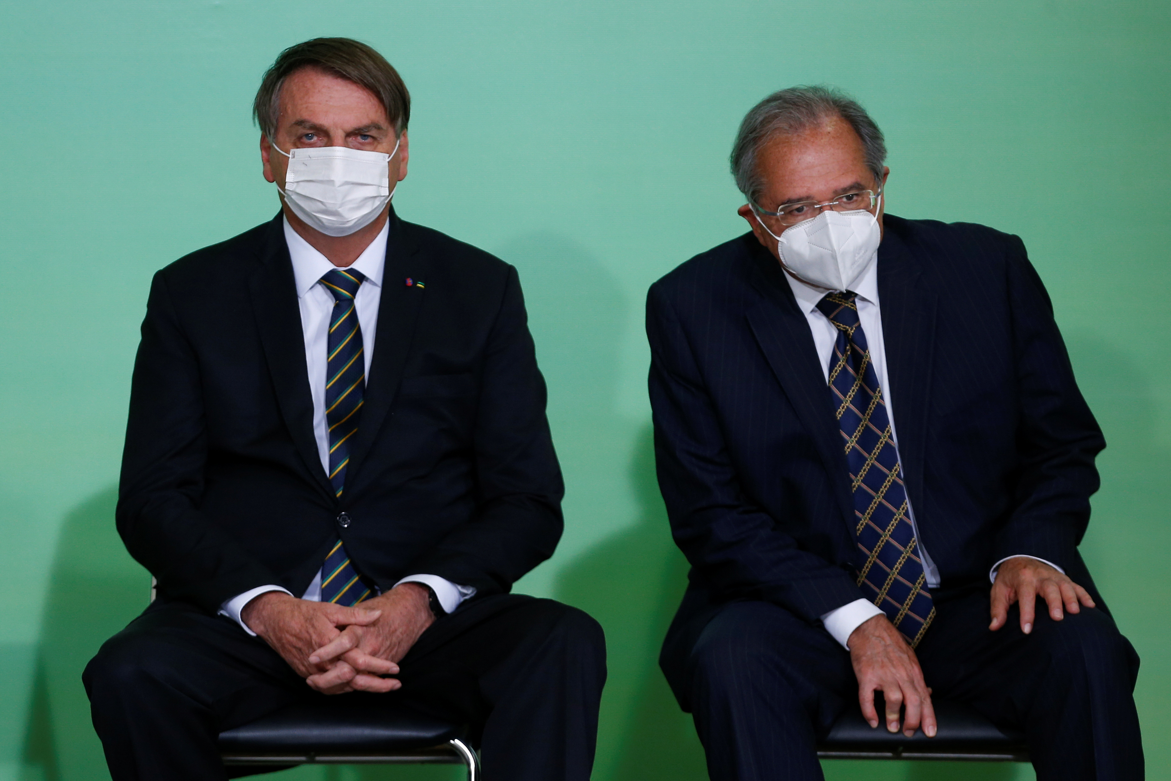 Brazil's President Jair Bolsonaro and Economy Minister Paulo Guedes attend a ceremony at the Planalto Palace, amid the coronavirus disease (COVID-19) pandemic, in Brasilia, Brazil, June 10, 2021. REUTERS/Adriano Machado