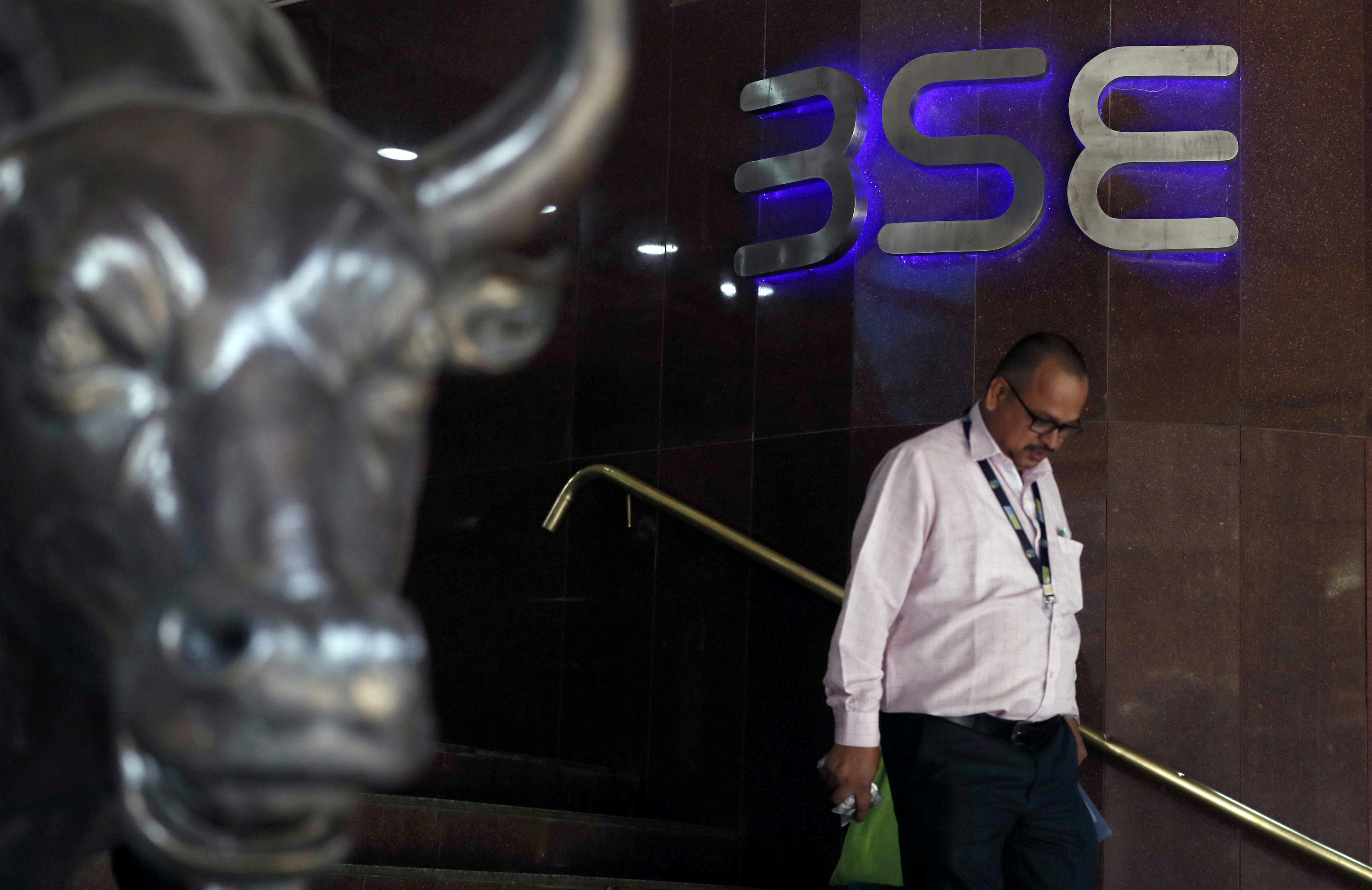 A man walks out of the Bombay Stock Exchange (BSE) building in Mumbai, India, January 3 2020. REUTERS/Francis Mascarenhas/File Photo